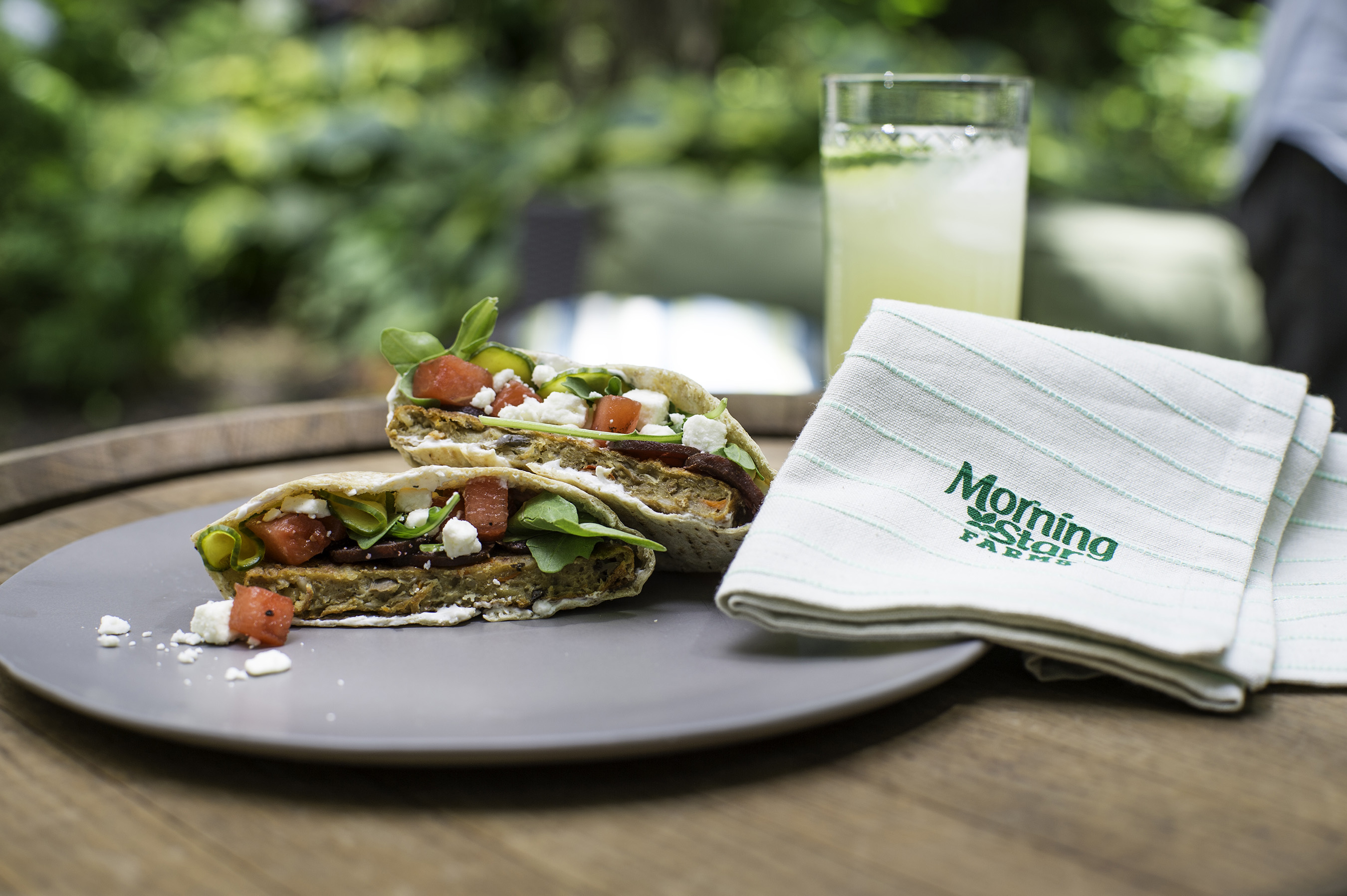 MorningStar Farms® Grillers® Original Burger served with herbed yogurt, cucumbers, watermelon and feta cheese inside a pita shell