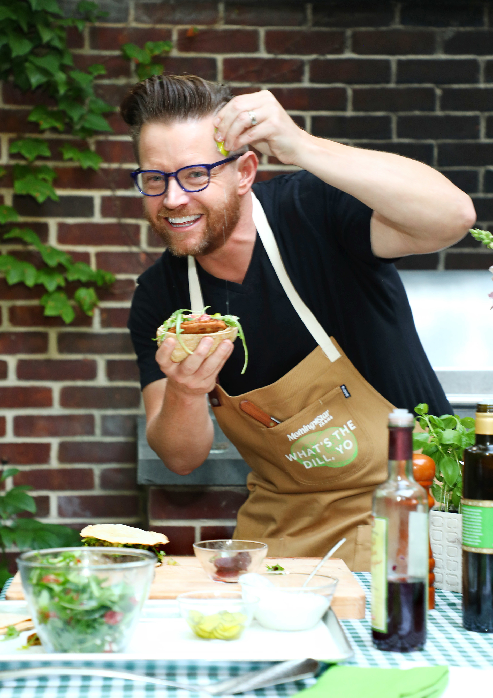 Chef Richard Blais prepares four new MorningStar Farms® veggie burger recipes at a backyard cookout in New York City, on July 26, 2017. (Sara Weiss / The Kellogg Company)