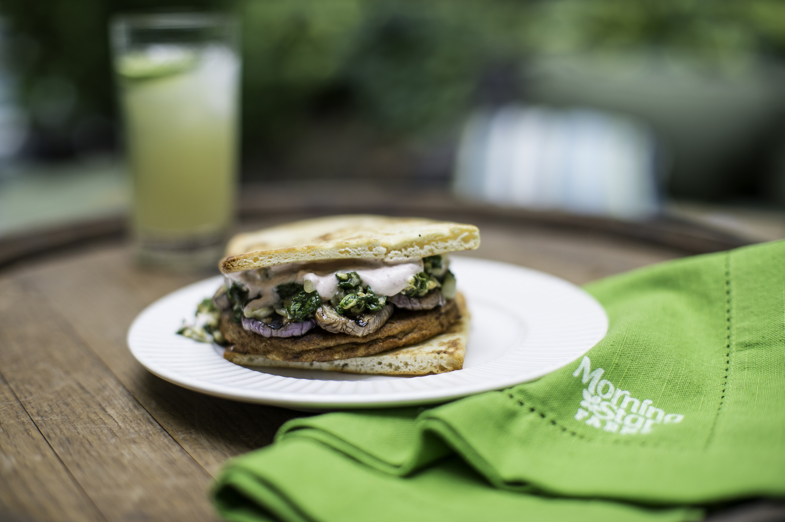 MorningStar Farms® Grillers® Original Burger topped with yogurt mixed with tandoori spices, spinach infused with garam masala and eggplant, served on garlic naan bread