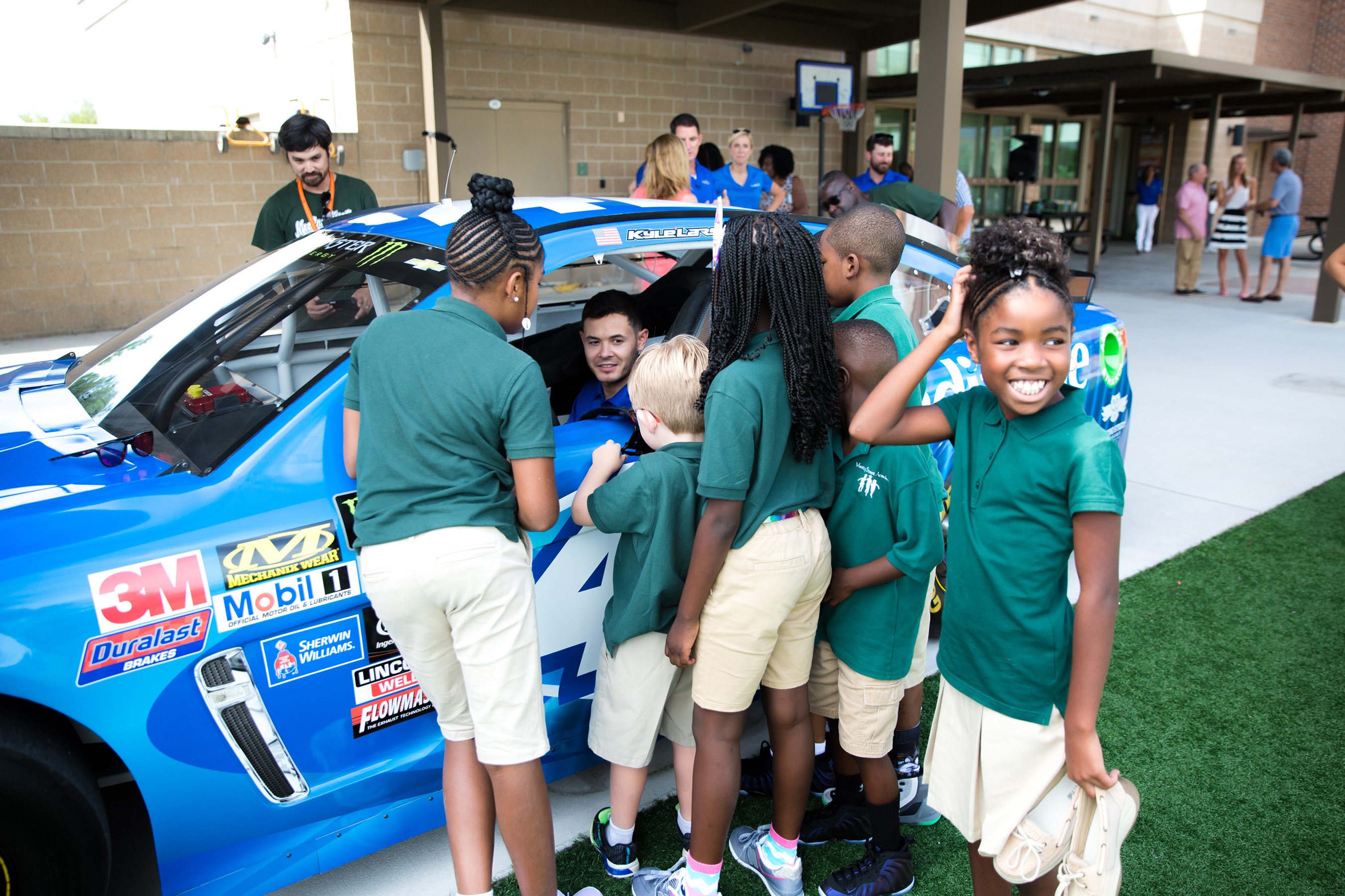 Kyle Larson, NASCAR driver, shows the Credit One Bank No. 42 Chevrolet SS to Meeting Street Academy students in Charleston, S.C. on Wednesday, August 2, 2017. (Minette Hand Photography)