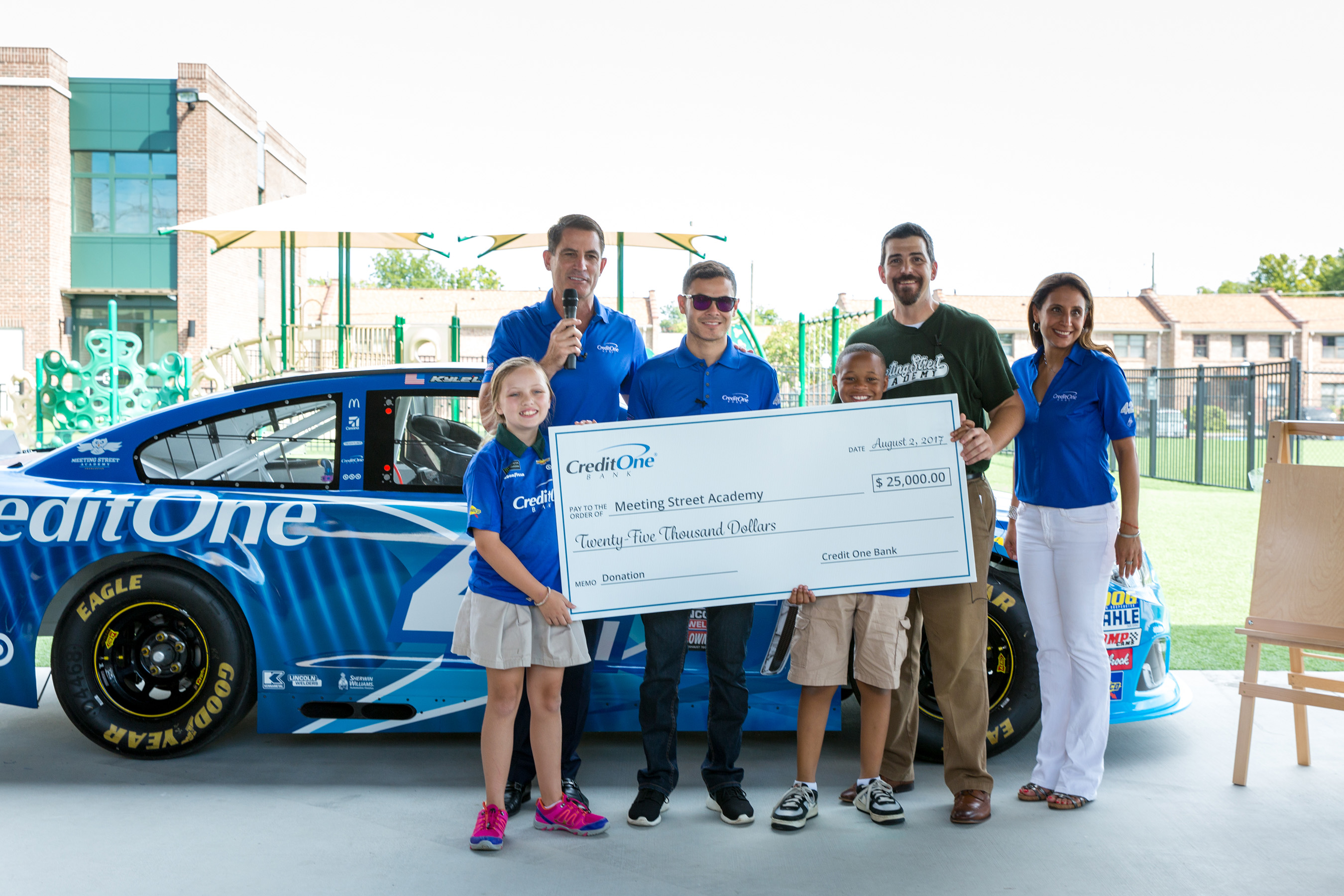 Credit One Bank president Robert DeJong & SVP of marketing Mamta Kapoor joined by Kyle Larson, present $25,000 to Meeting Street Academy students and principal Dirk Bedford. (Minette Hand Photography)