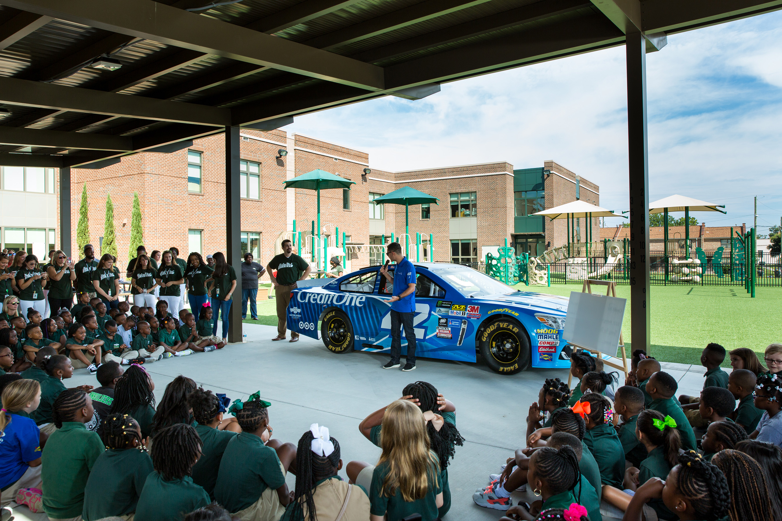 NASCAR driver Kyle Larson, shows the Credit One Bank No. 42 Chevrolet SS to students at Meeting Street Academy in Charleston, S.C. on Wednesday, August 2, 2017. (Minette Hand Photography)