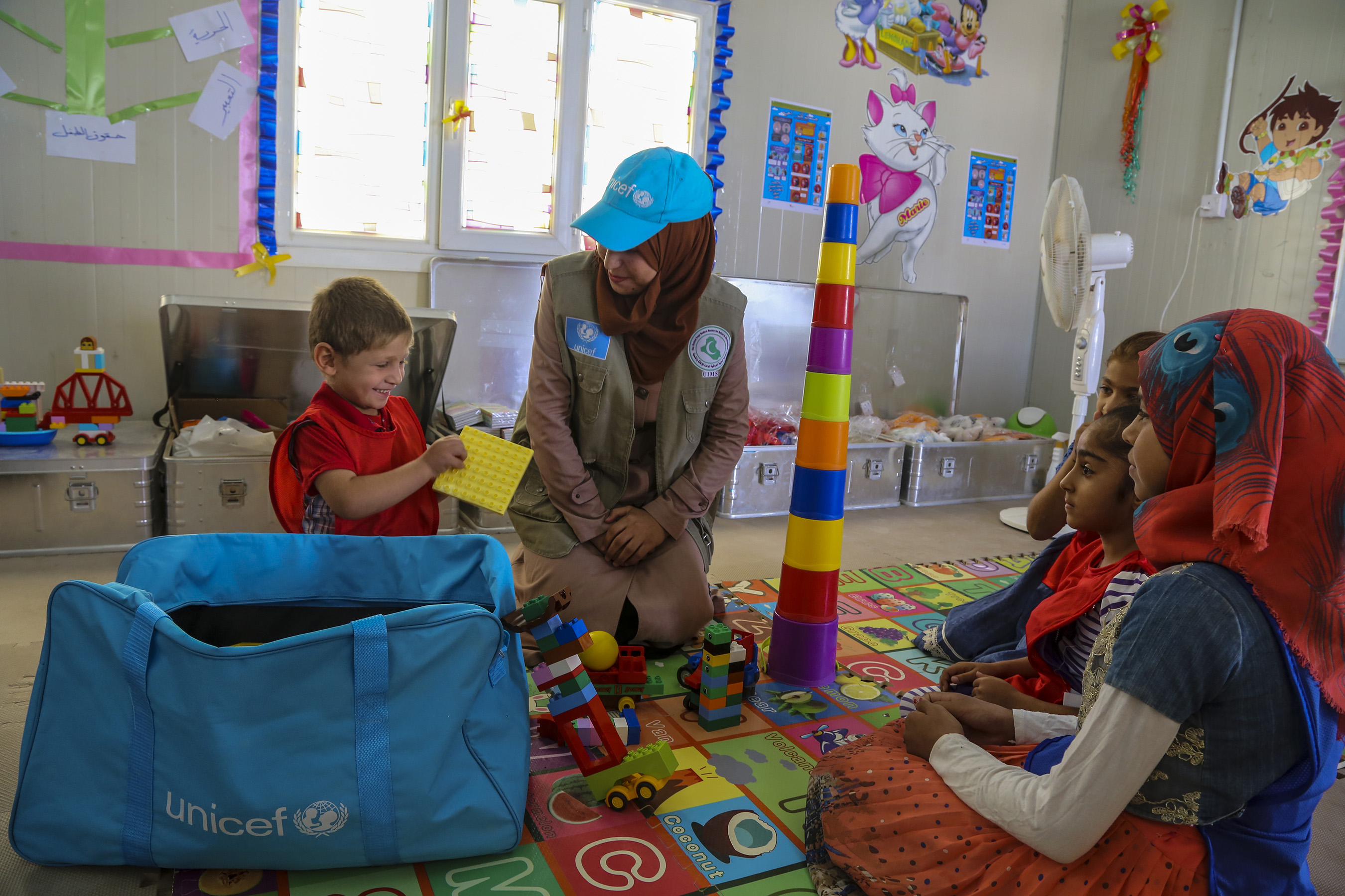 UNICEF interacts with children in Child Friendly Spaces to help them learn, thrive and reconnect with one another | Credit: ©UNICEFUN049380Khuzaie