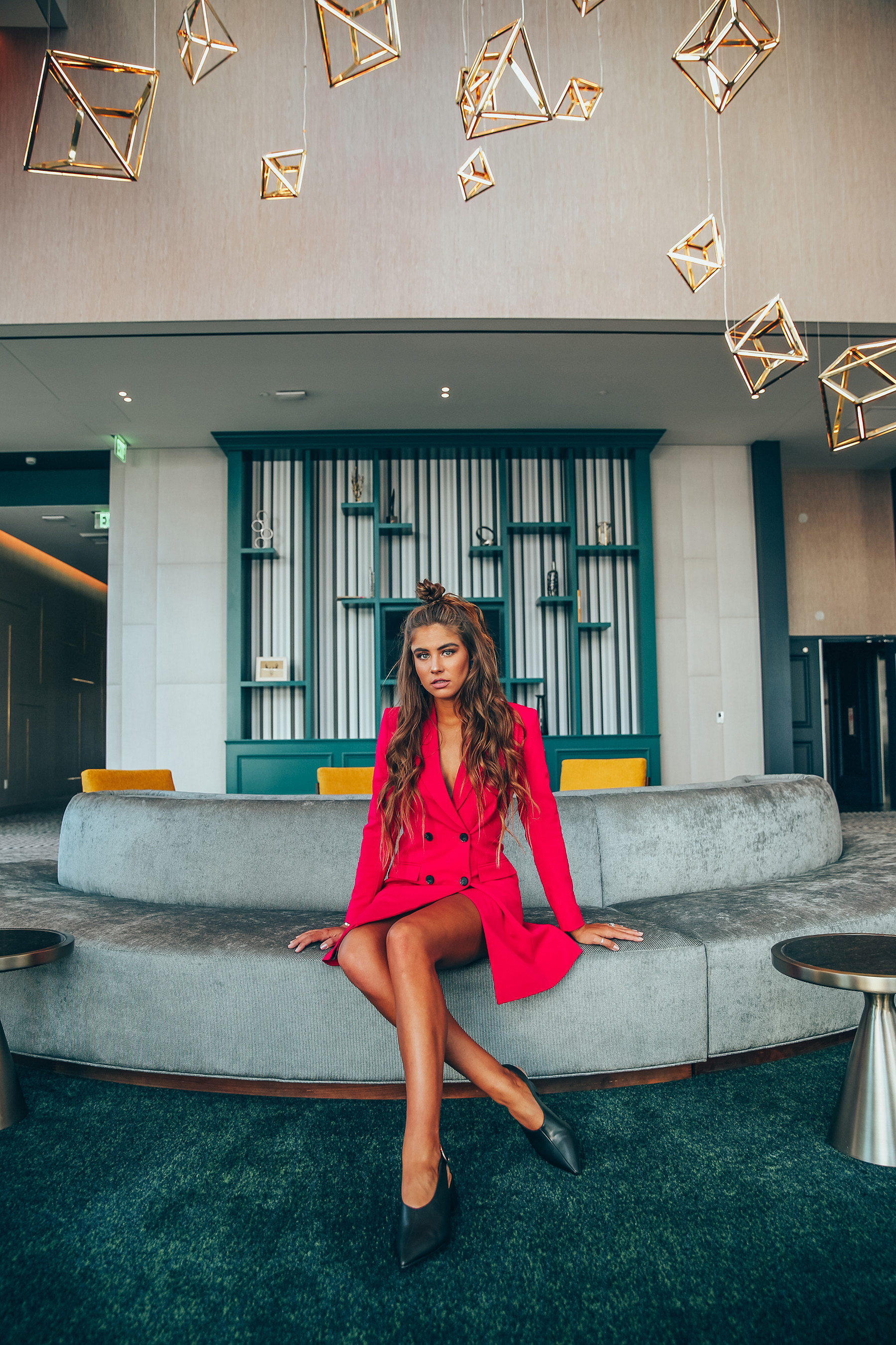 Influencer Jamie Kidd, wearing ASOS x Hotel Indigo Edits, waits for her ride in the Hotel Indigo Los Angeles Downtown lobby before heading out to experience the local neighborhood nightlife. Photo Credit: ASOS®