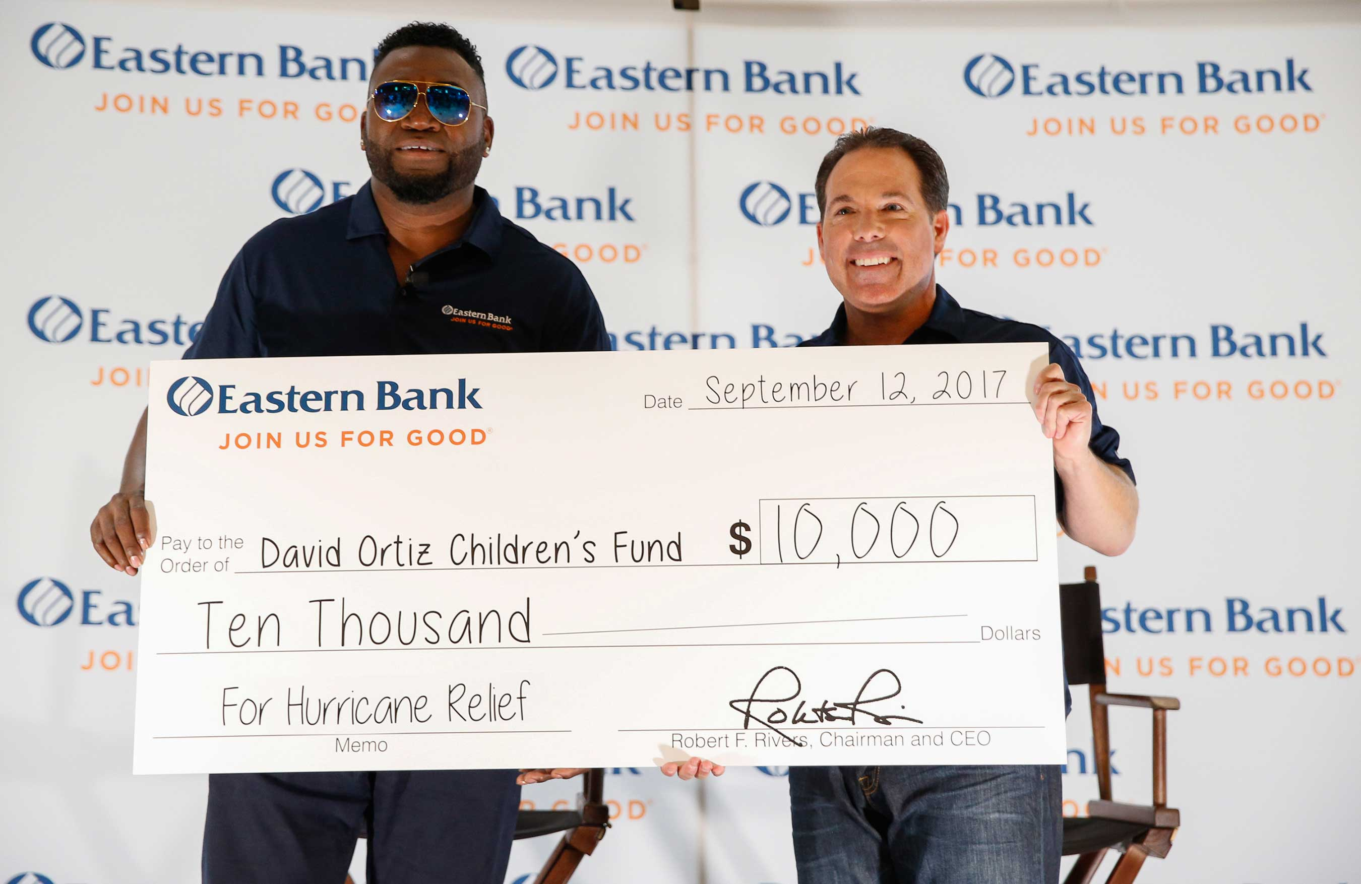 "David Ortiz, Eastern Bank's newest ""Partner For Good"" accepts a check in the amount of $10,000, which will be used to provide critical support to communities that were impacted by Hurricane Irma."