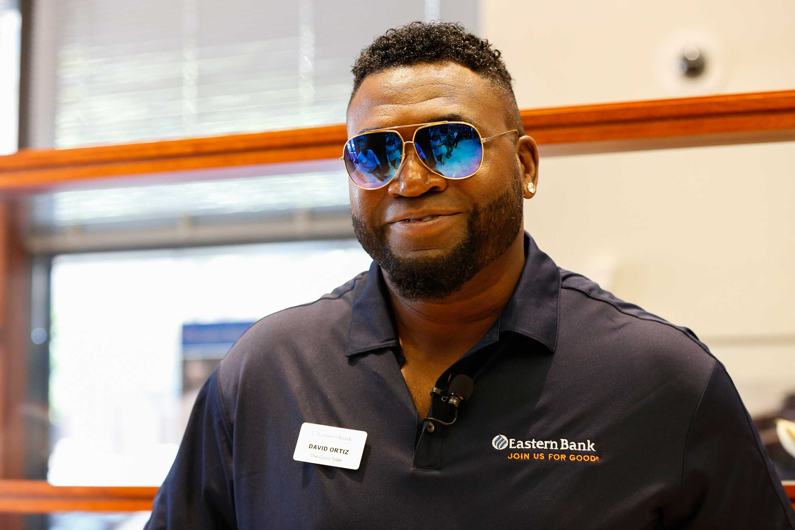 "David Ortiz steps out of retirement for a day to serve as Eastern Bank's ""Good Teller,"" as part of its Join Us For Good movement."