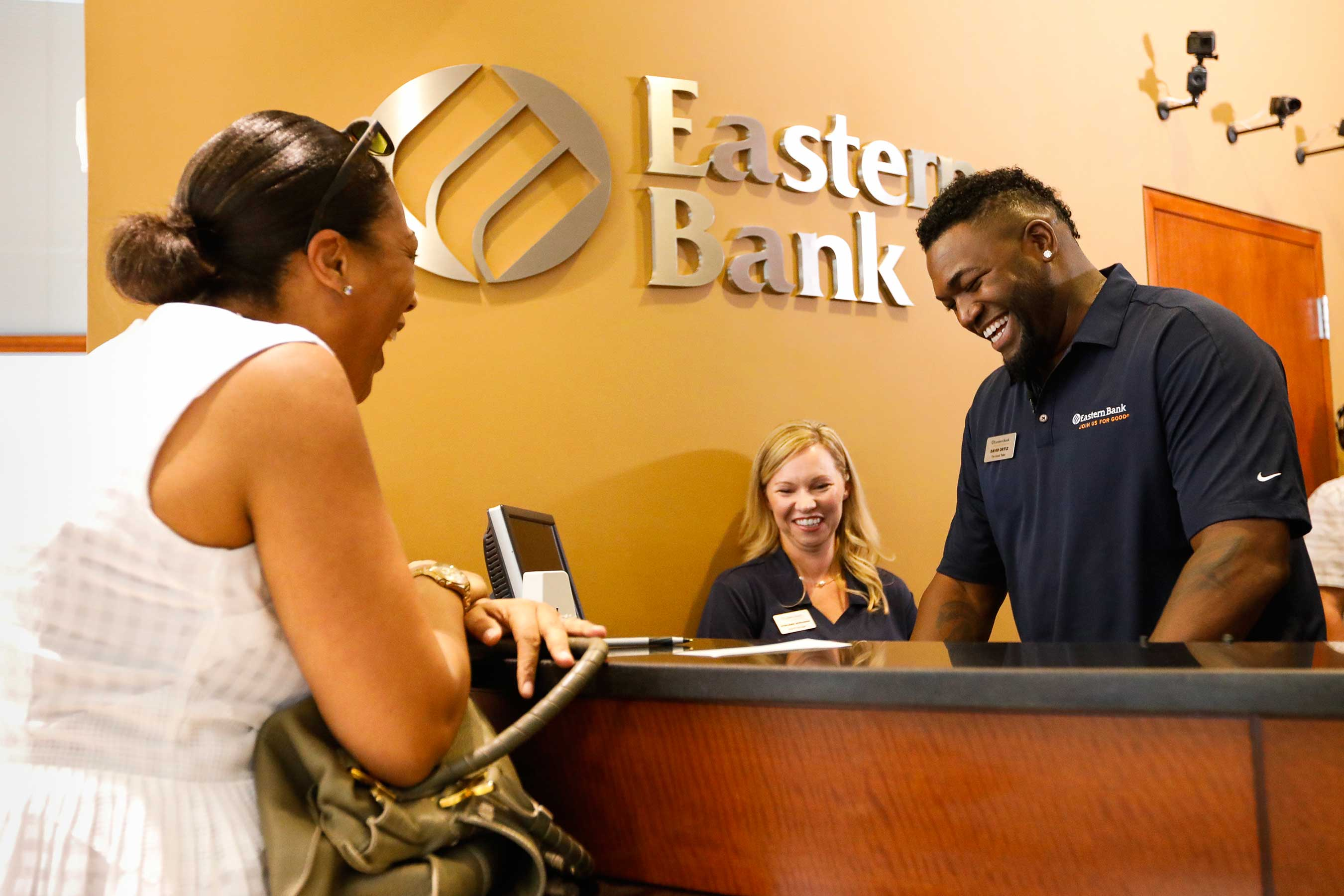 Baseball icon David Ortiz surprises an unsuspecting Eastern Bank customer during an event in Boston on September 12, 2017.