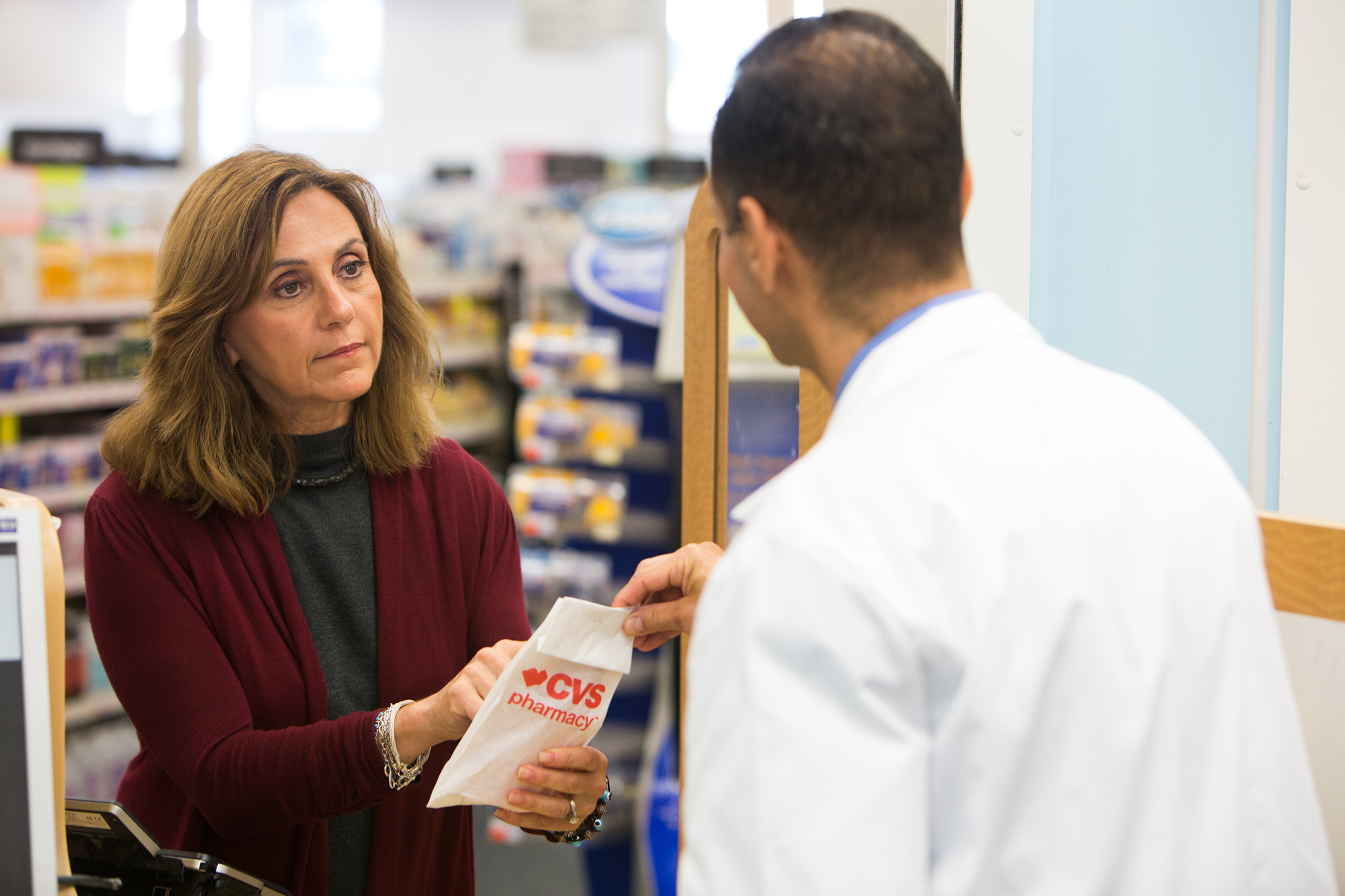 Pharmacist consults with patient