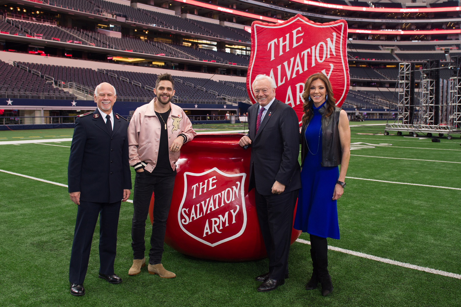 Commissioner David Hudson of The Salvation Army, Red Kettle Kickoff artist Thomas Rhett, Jerry Jones and Charlotte Jones Anderson of the Dallas Cowboys