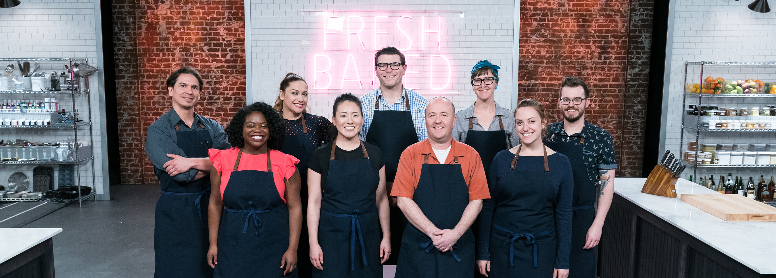 The contestants of Food Network's Best Baker in America standing in kitchen
