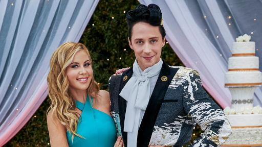Hosts Tara Lipinski in a turquoise dress and Johnny Weir in a suit on Food Network's Wedding Cake Championship