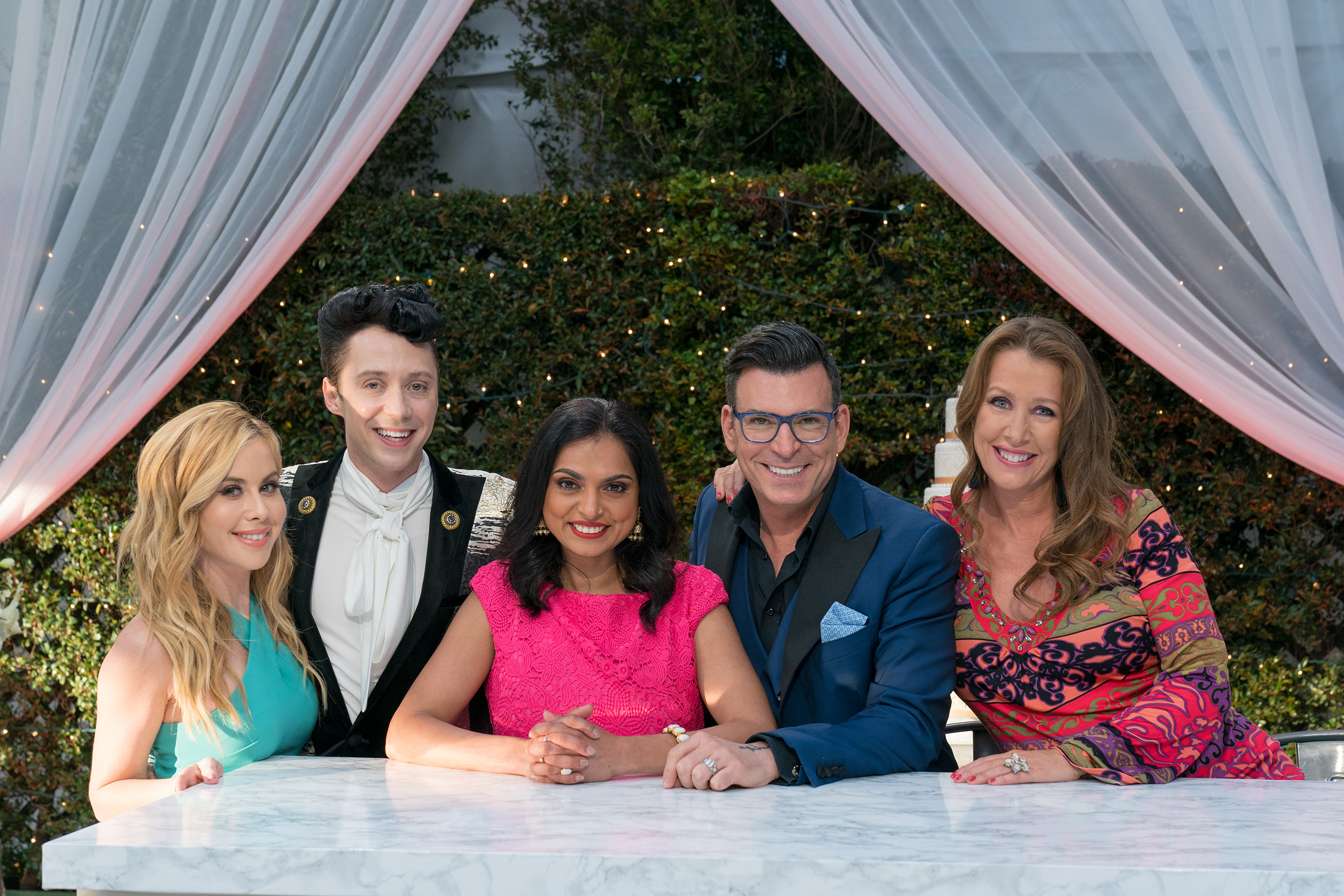 Tara Lipinski and Johnny Weir with judges Maneet Chauhan, David Tutera and Kimberly Bailey on Food Network's Wedding Cake Championship