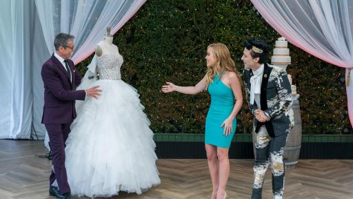Randy Fenoli showing off a wedding dress with Tara Lipinski and Johnny Weir, on Food Network's Wedding Cake Championship