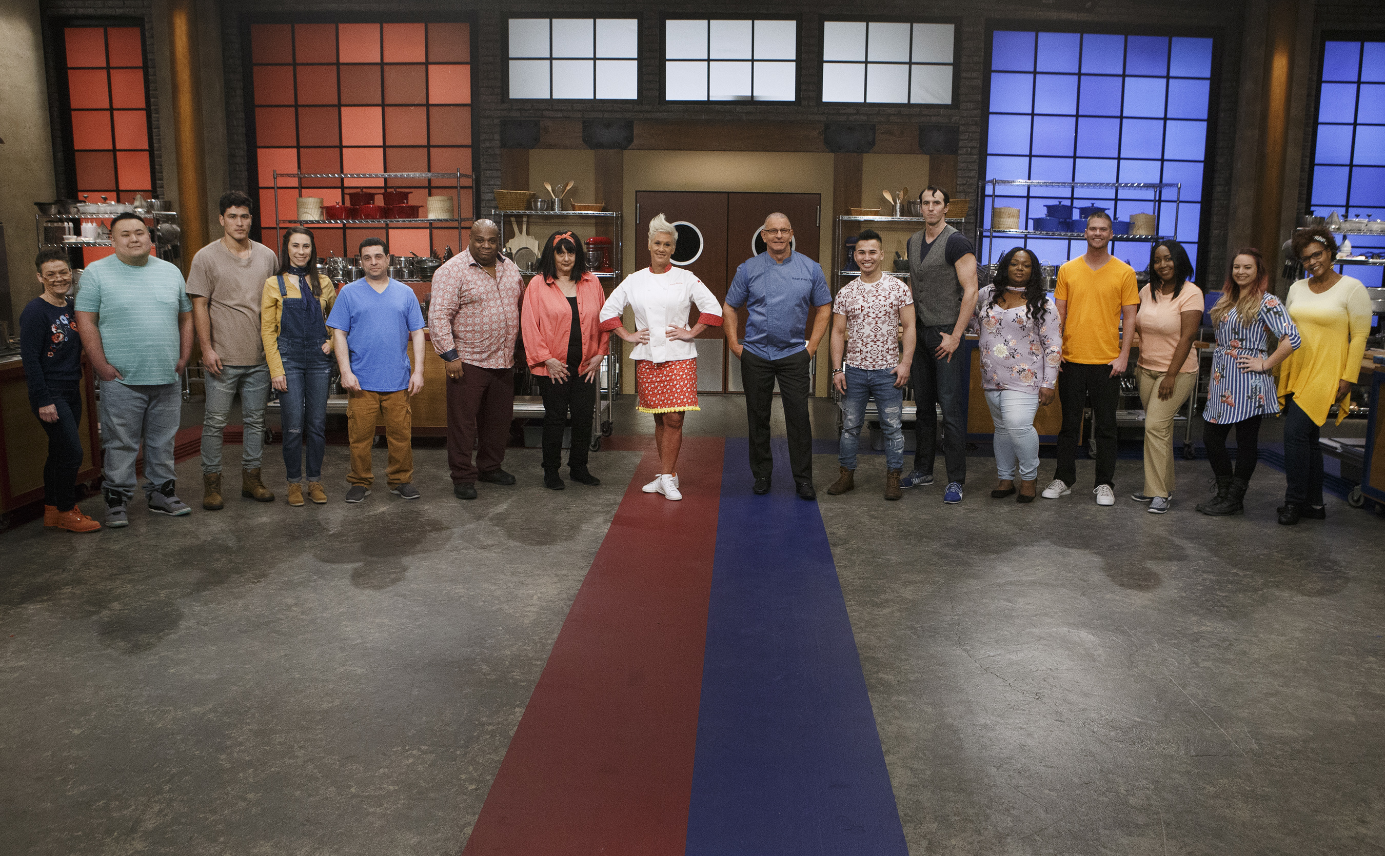 Anne Burrell and Robert Irvine with the recruits on Food Network's Worst Cooks in America