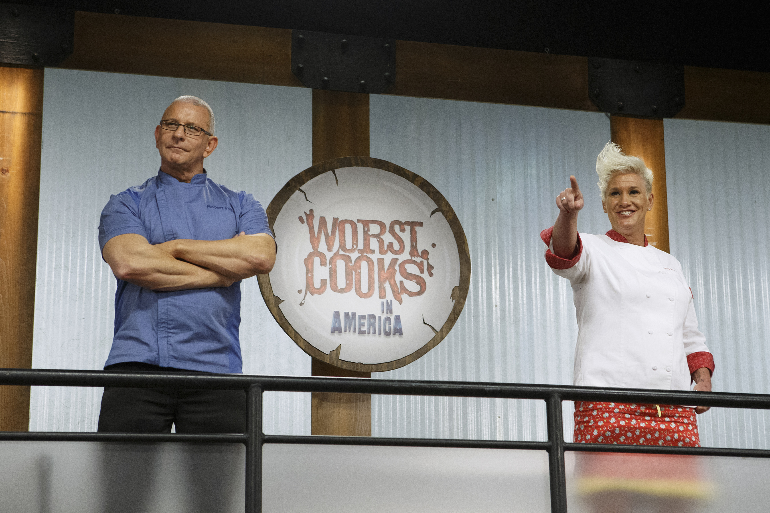 Robert Irvine and Anne Burrell watch over the recruits on Food Network's Worst Cooks in America