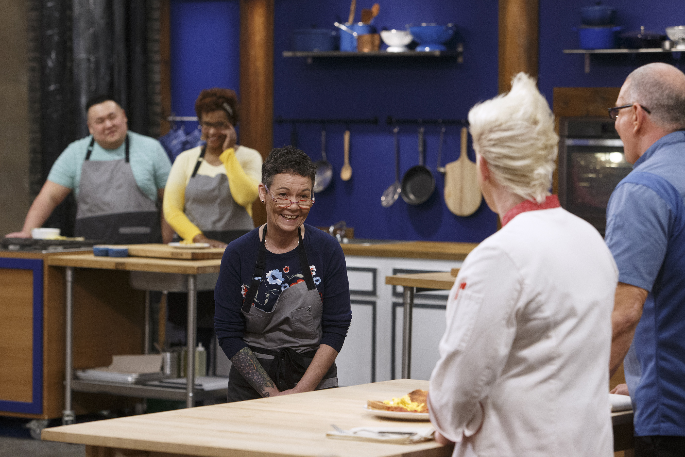 Robert Irvine and Anne Burrell evaluate recruit Linda Martin's dish on Food Network's Worst Cooks in America