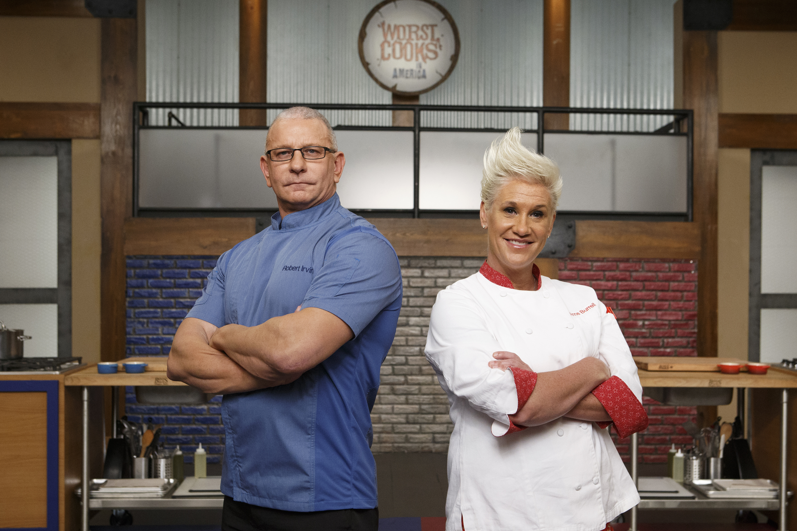 Robert Irvine and Anne Burrell pose together on Food Network's Worst Cooks in America