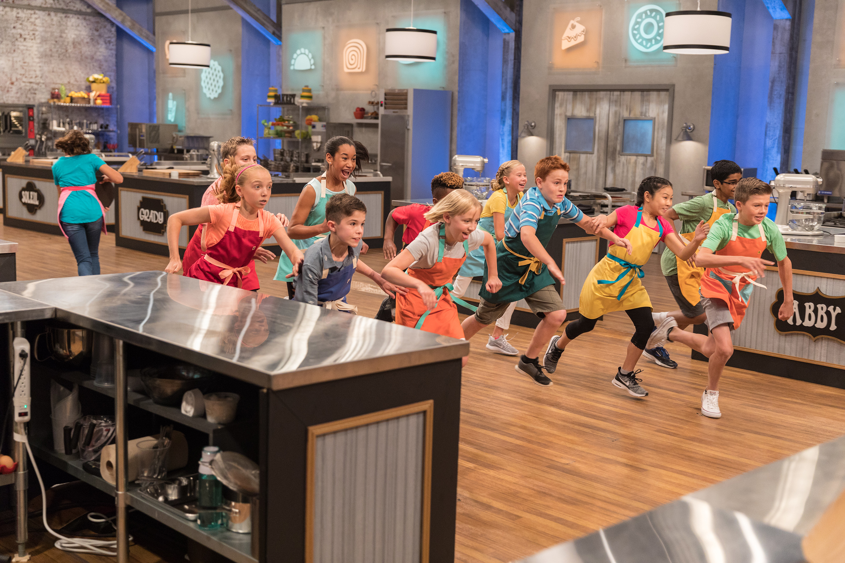 The contestants getting ready to compete on Food Network's Kids Baking Championship