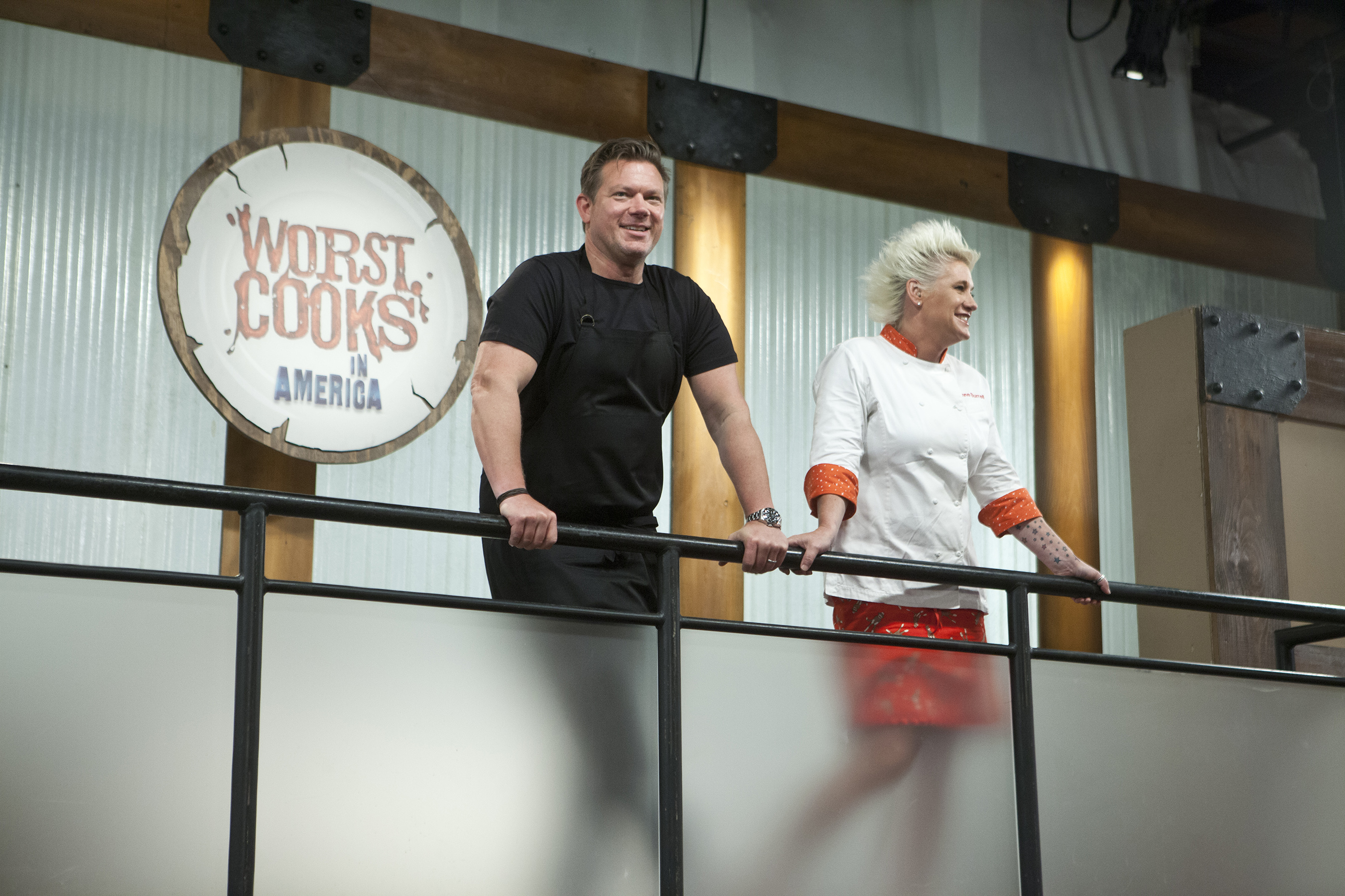 Tyler Florence and Anne Burrell watching over the recruits on Food Network's Worst Cooks in America