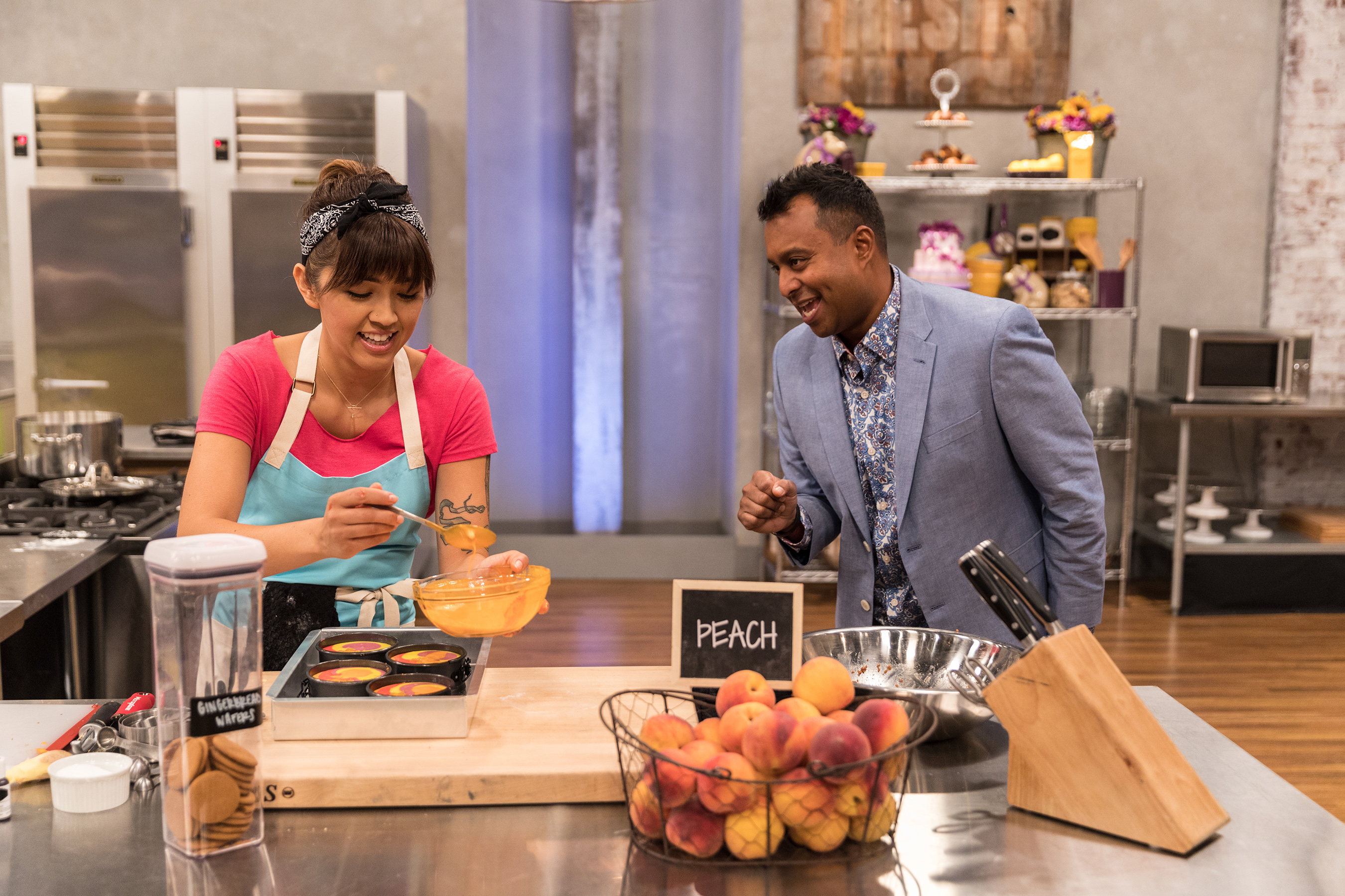 Ali Khan checks in on competitor on Food Network's Spring Baking Championship