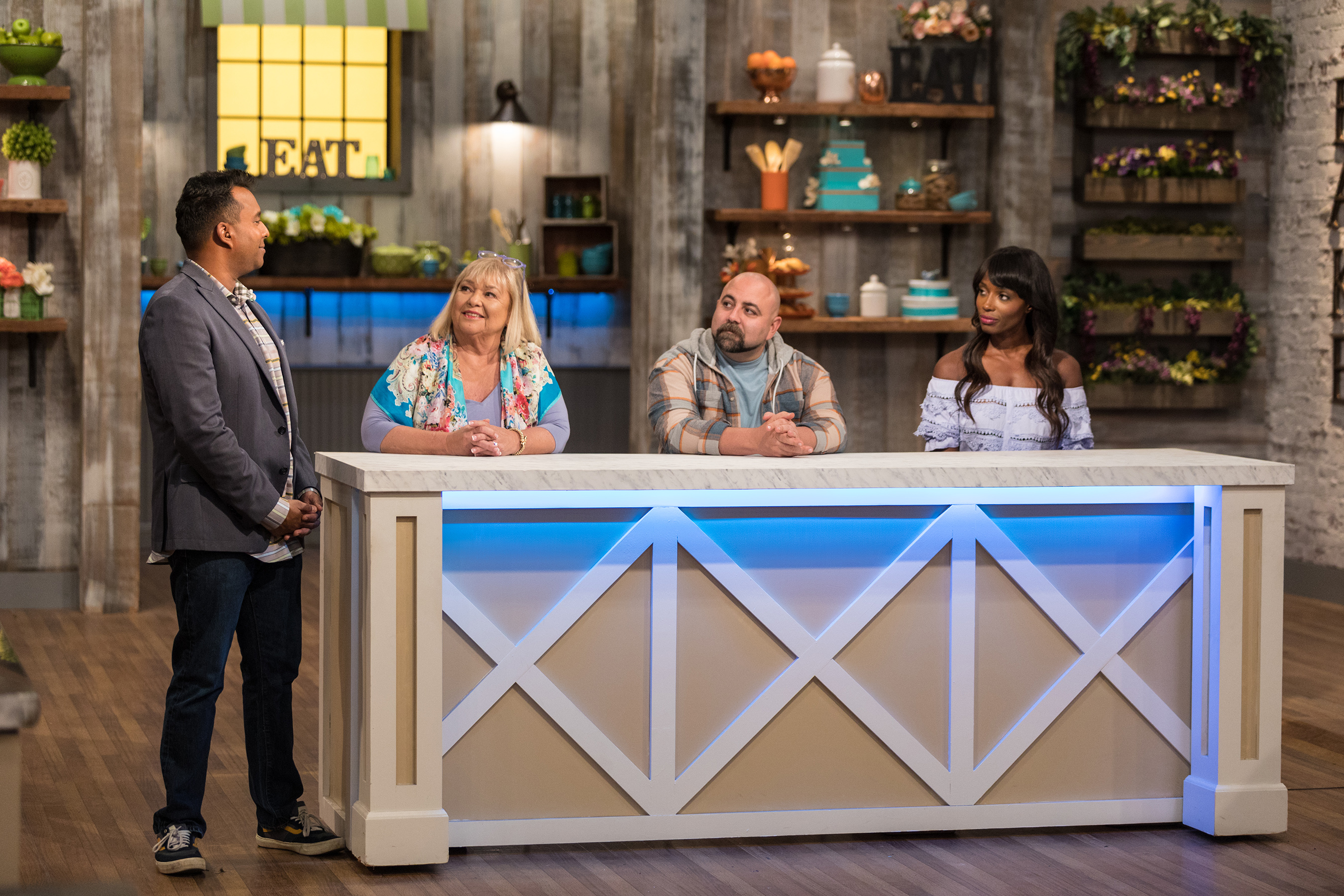 Ali Khan meets with the judges, Nancy Fuller, Duff Goldman and Lorraine Pascale, on Food Network's Spring Baking Championship