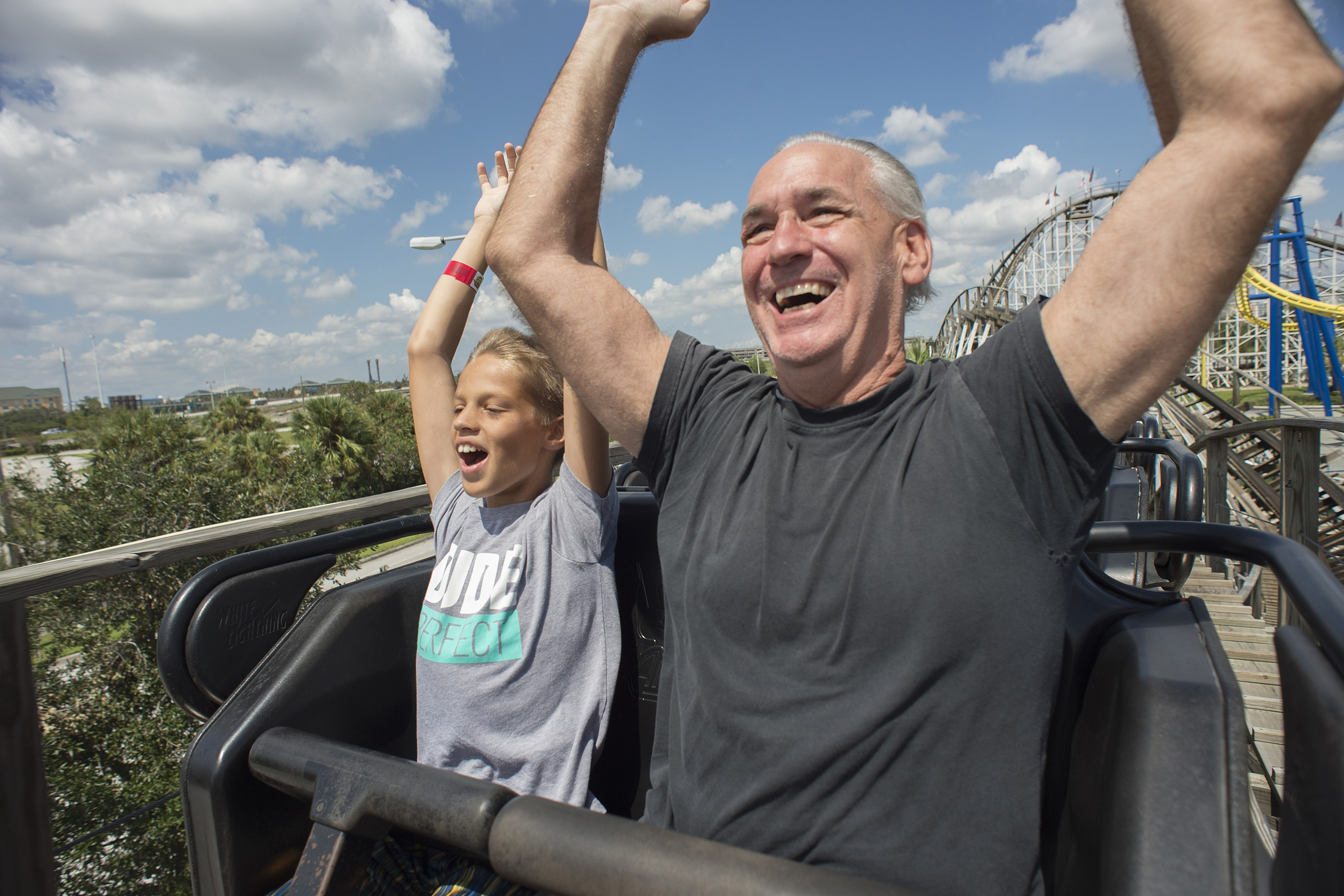 Visitors Luke Spinelli and Bret Boeddinhaus enjoy a ride on White Lightning at Fun Spot Orlando.