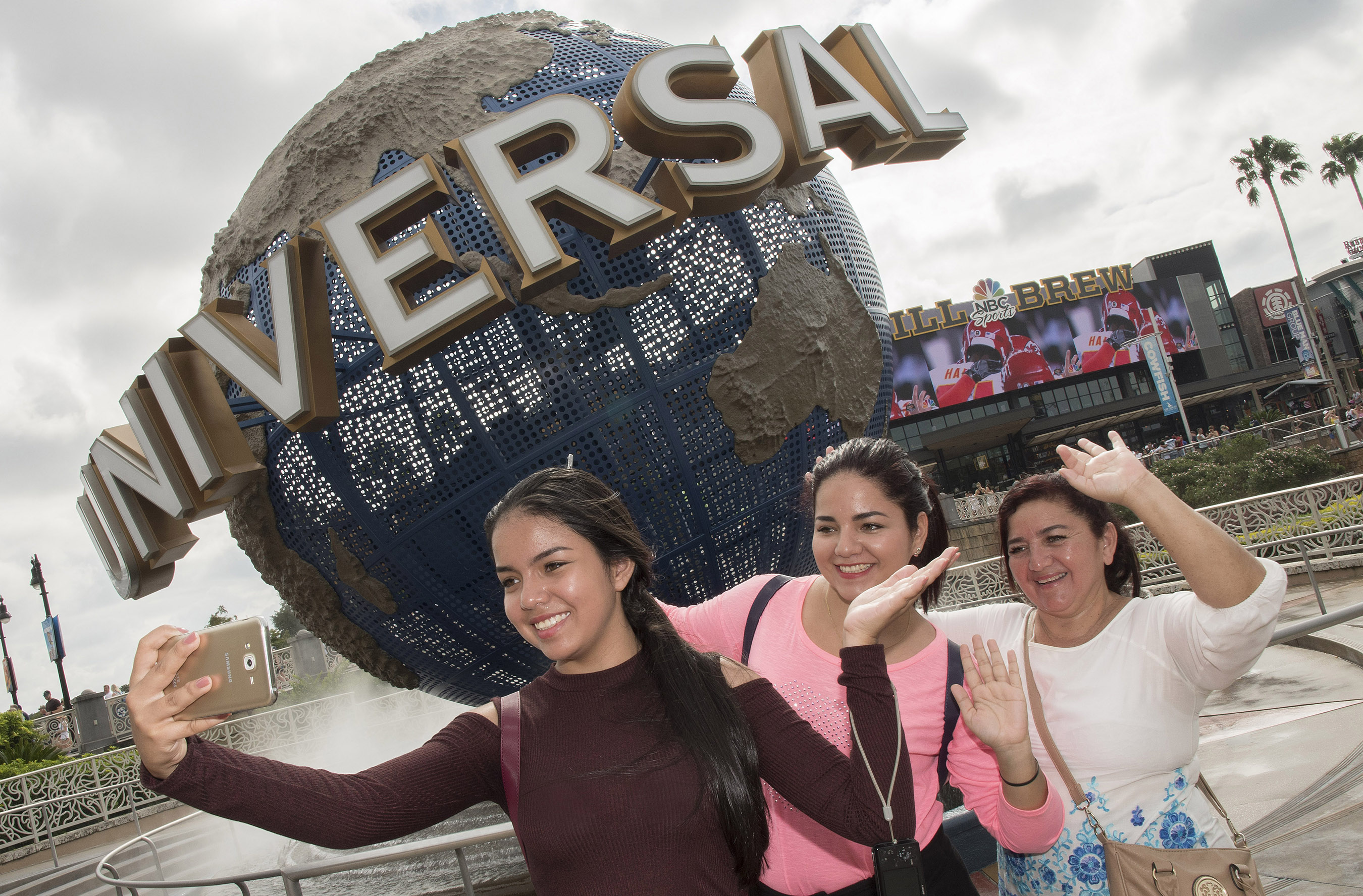 To commemorate the start of their day at Universal Orlando Resort, Olga Rodiguez and Ambar and Michell Cuichan from Guayaquil, Ecuador pose for a selfie.