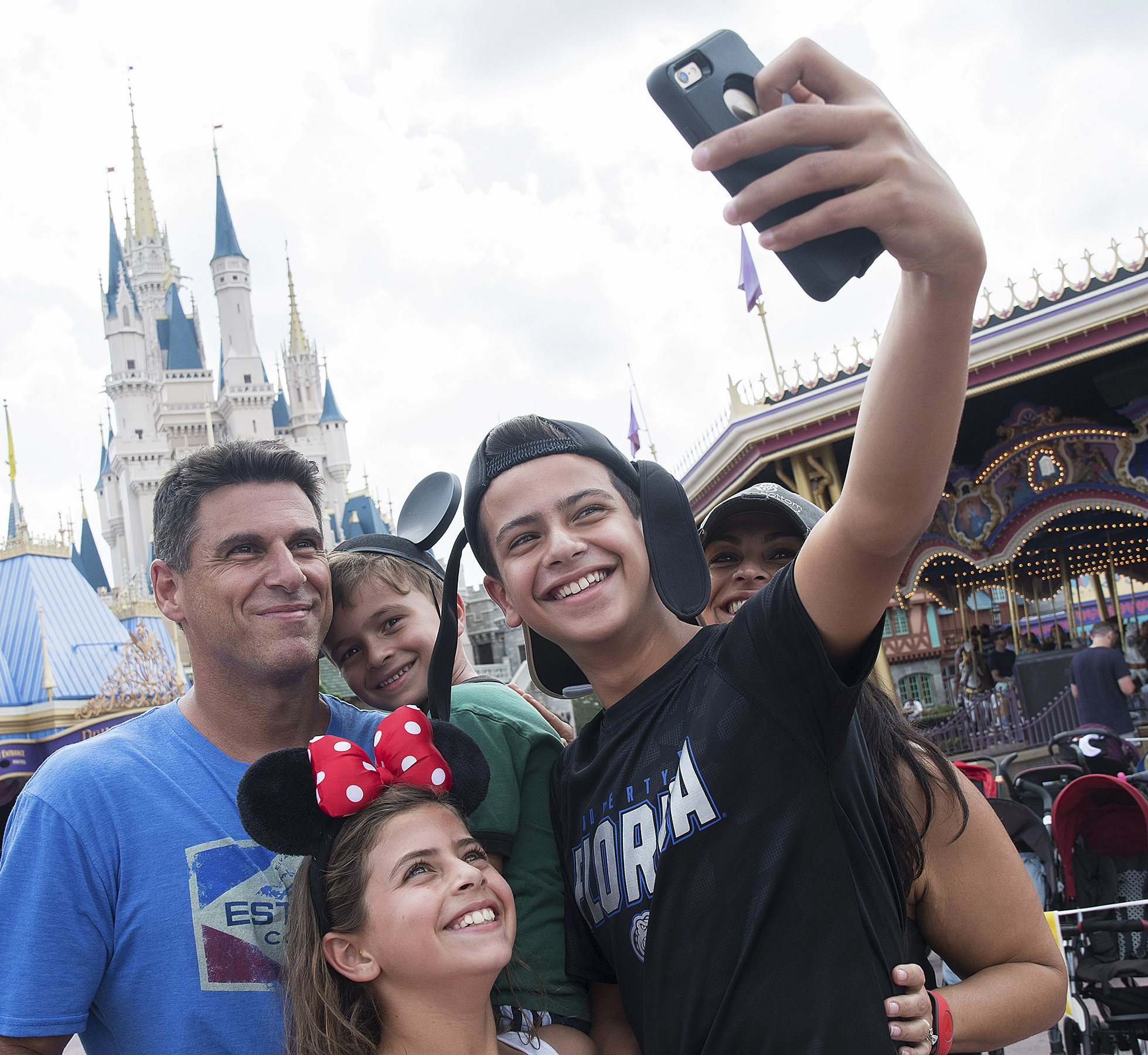 The Sussman family from Weston, Florida snaps a fun selfie in front of the iconic Cinderella Castle at Walt Disney World Resort, just days after the storm.