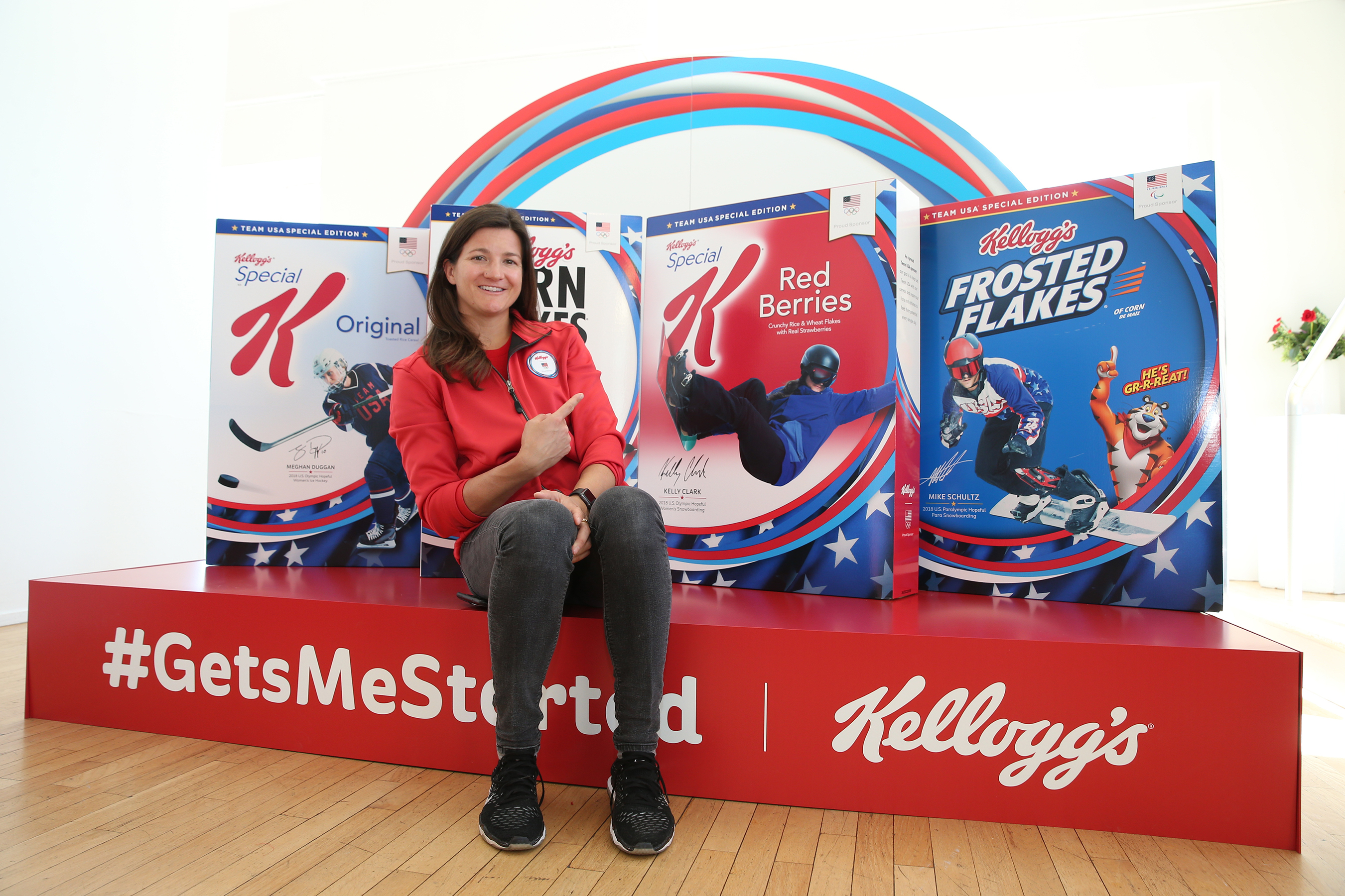 U.S. Olympic Hopeful, Kelly Clark, sees her face on a Kellogg's cereal box for the first time at the Team Kellogg's 100 Days Out celebration.