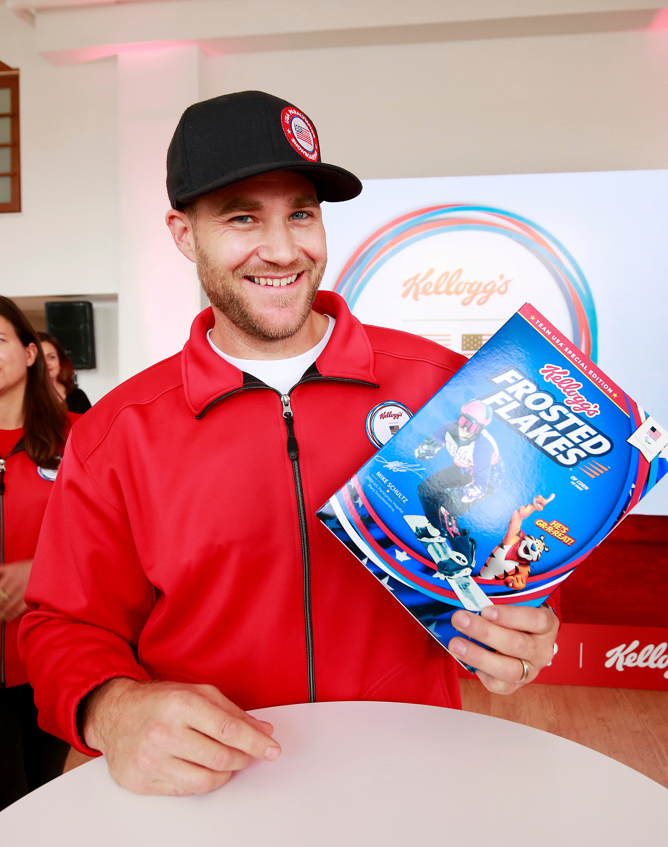 U.S. Paralympic Hopeful, Mike Schultz, sees his face on a Kellogg's cereal box for the first time at the Team Kellogg's 100 Days Out celebration.