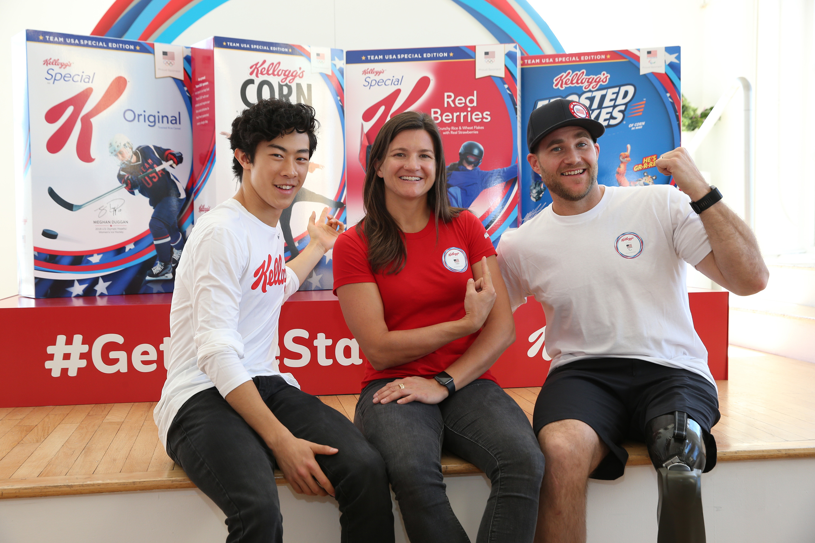 Team USA Hopefuls Nathan Chen, figure skating, from left, Kelly Clark, snowboarding, and Mike Schultz, Paralympic snowboarding, pose with limited-edition cereal boxes. Along with Meghan Duggan, ice hockey (not pictured), the athletes were introduced as Team Kellogg's.