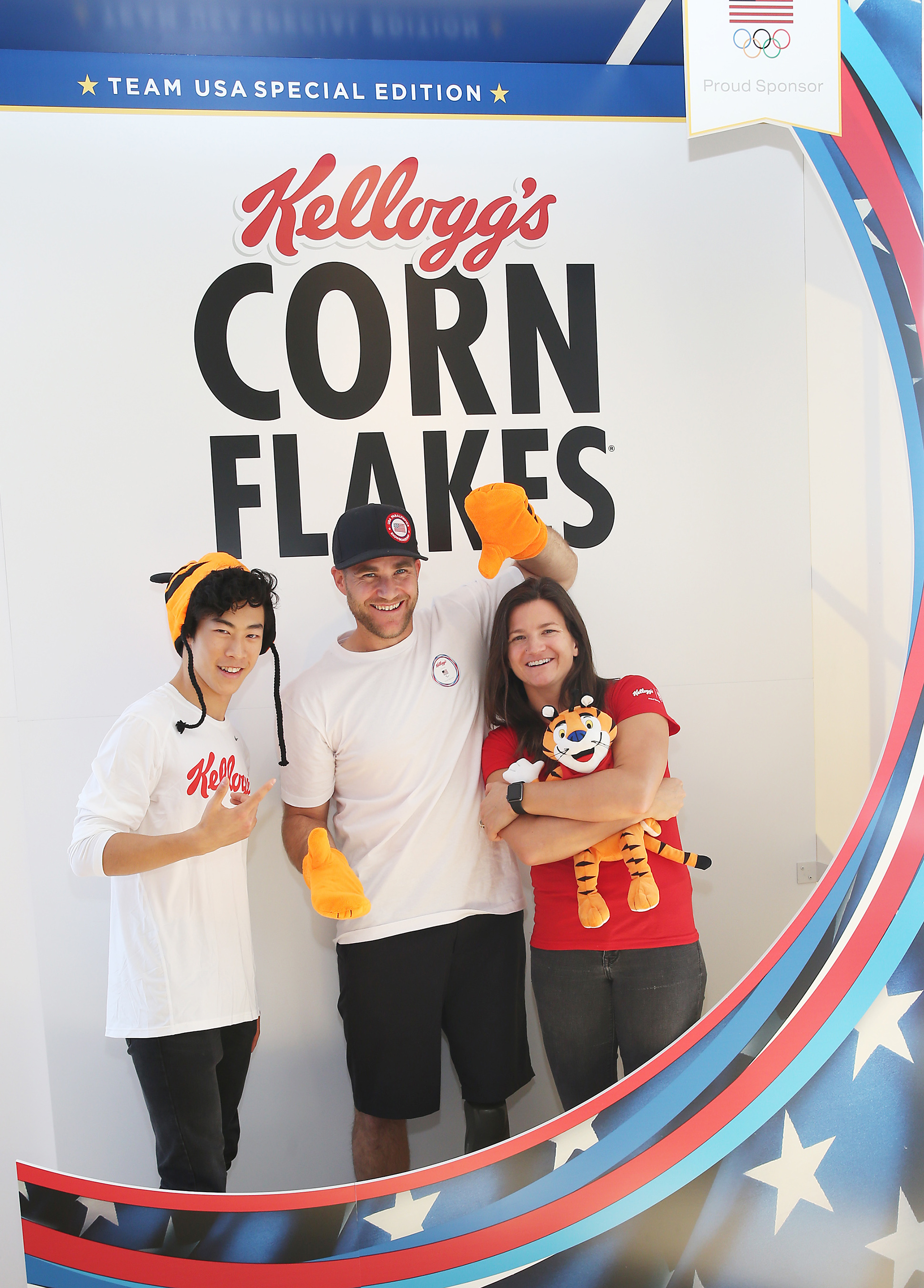 Newly introduced Team Kellogg's athletes and Team USA hopefuls Nathan Chen, figure skating, from left, Mike Schultz, Paralympic snowboarding, and Kelly Clark, snowboarding, strike a pose in the Corn Flakes photo booth.