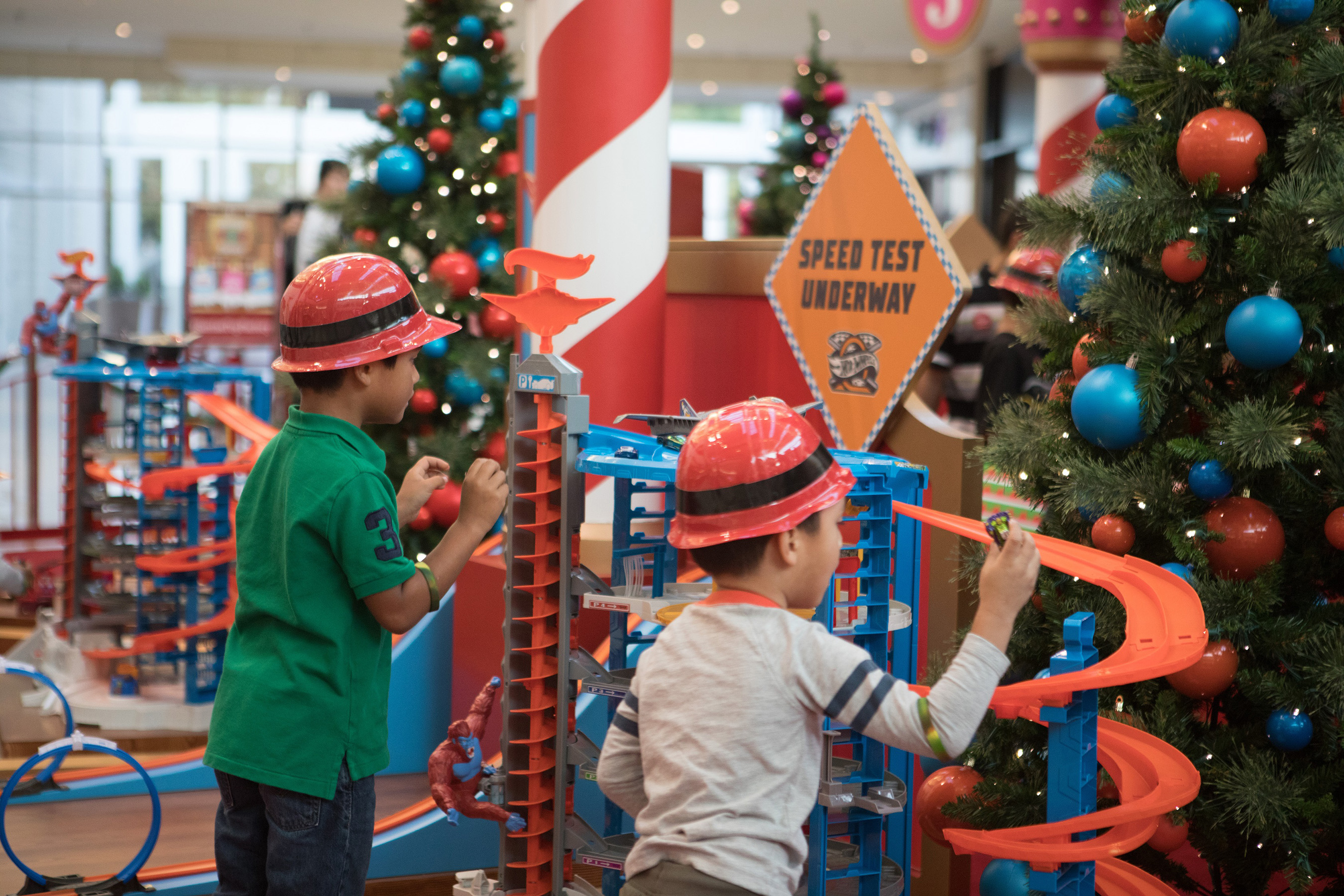 Children love to play with Hot Wheels® at Santa's Toy Factory.