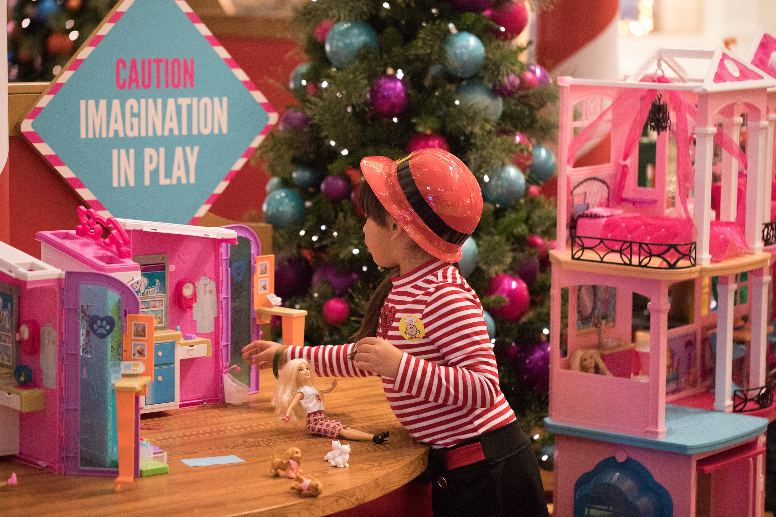 Fun with Barbie® DreamHouse at Santa's Toy Factory! What little girl would resist?