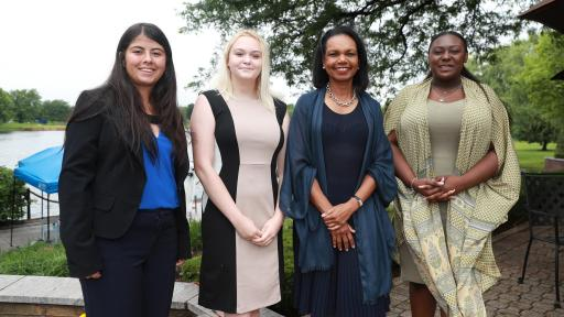 Dr. Condoleezza Rice poses with three representatives of the 2018 Future Leaders Class
