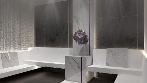 Grey and white room featuring a large chunk of crystal sitting between two seating areas.