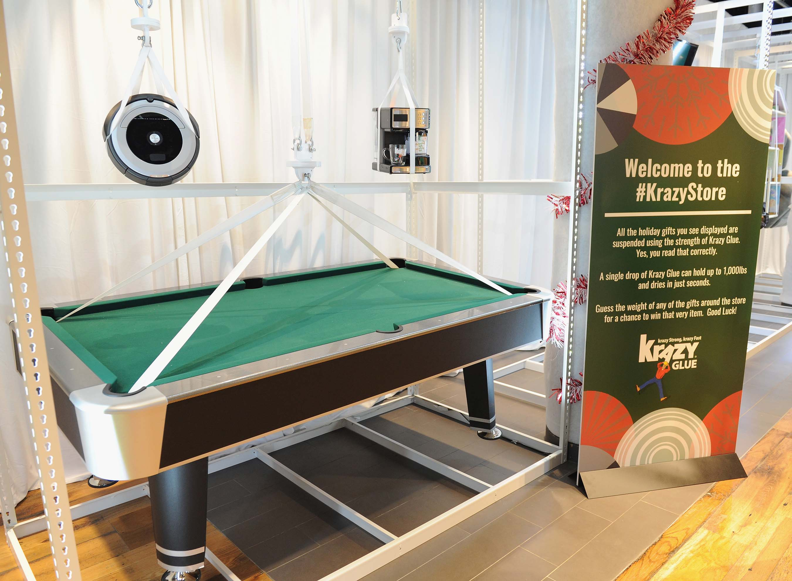 Did you know only a few drops of Krazy Glue® can hold up to 1,000 lbs.? Heavy gifts like a pool table, wine cooler and more were suspended on display at the Krazy Store using Krazy Glue.