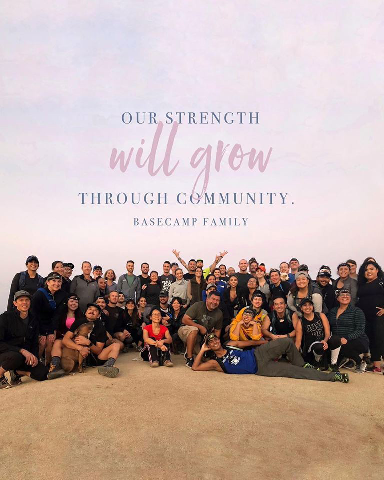 Members and staff from Basecamp Fitness in West Hollywood gather for a photo following a sunset hike.