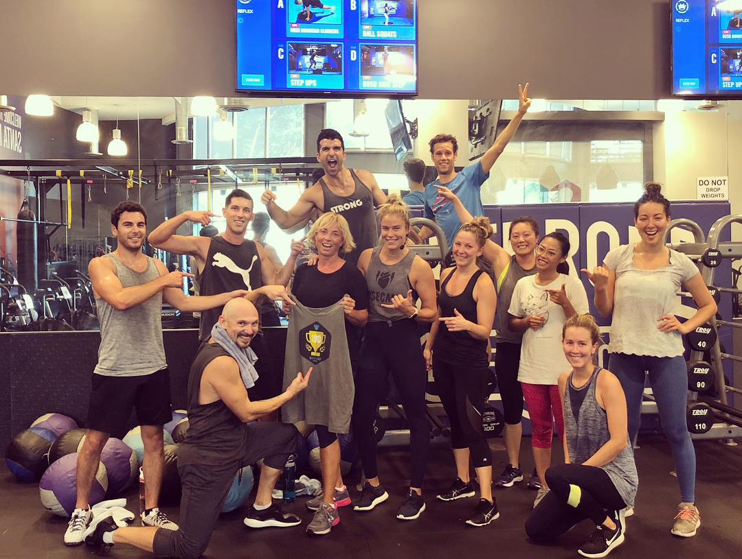 A member and friends celebrate her 100th workout at Basecamp Fitness in Santa Monica.