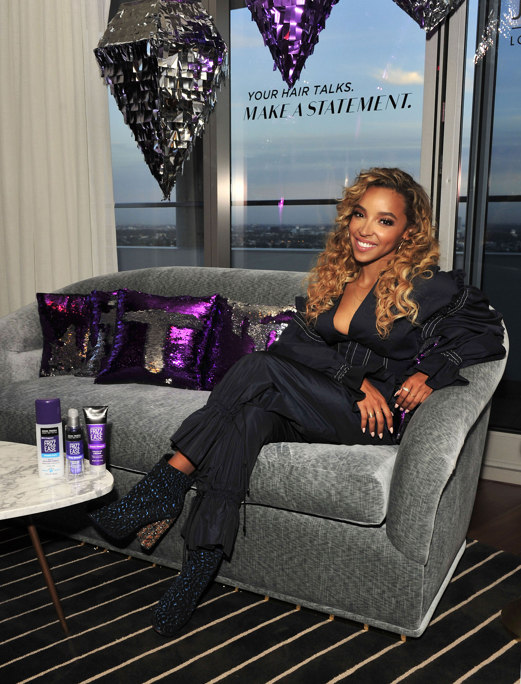 Tinashe celebrates the iconic John Frieda® Hair Care Frizz Ease® line