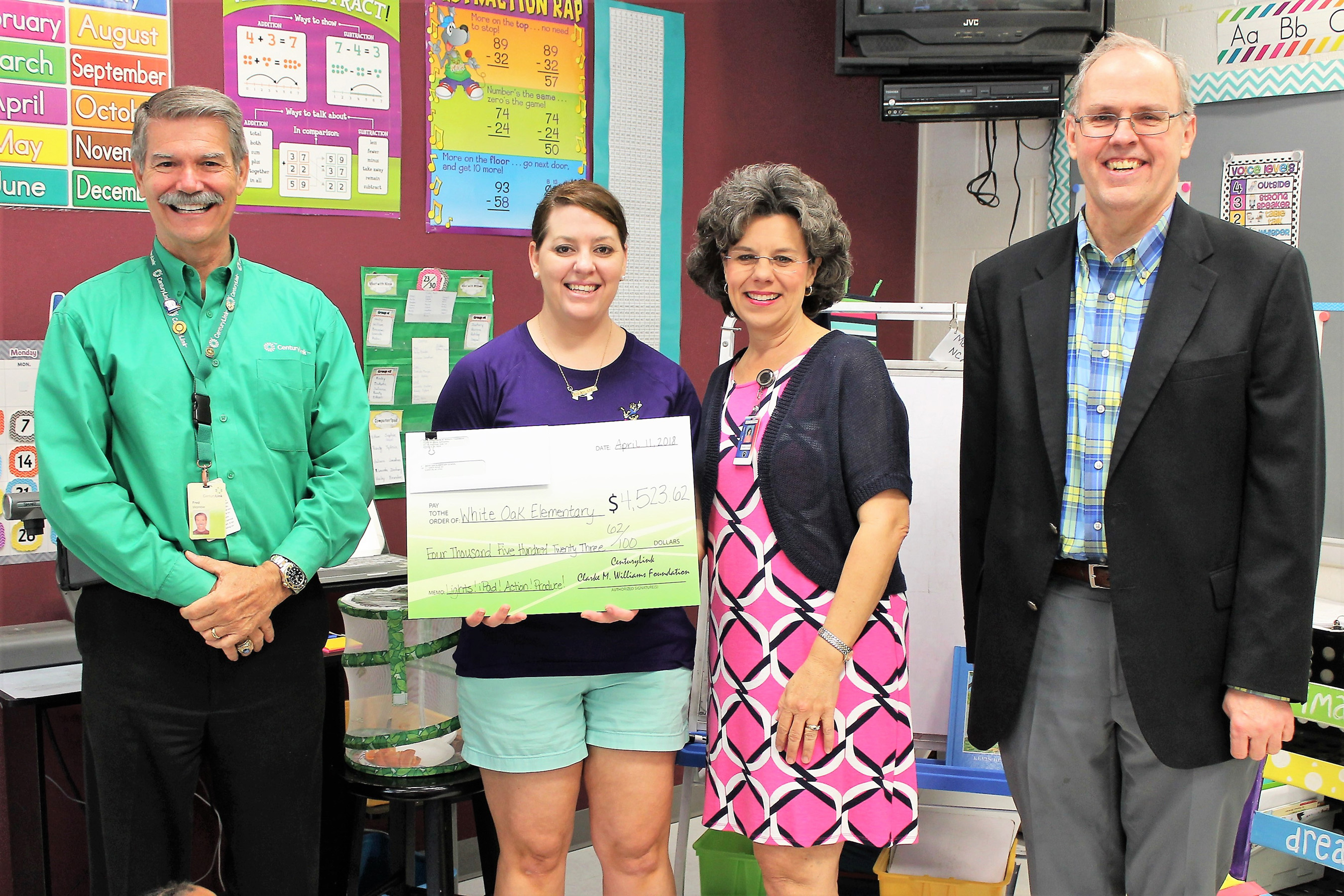 "LeAnn Nixon of White Oak Elementary School in Edenton, North Carolina, received a grant for $4,523 for her project titled ""Lights! iPad! Action! Produce!"" through the CenturyLink Clarke M. Williams Foundation's Teachers and Technology grant program. Students will plan and produce live stream productions integrating iPads, wireless microphones and a green screen live streaming app. They will incorporate their activities into reading, math, science, social studies and, in the future, cultural arts. In the photo are Fred Womble - CenturyLink Manager of Regional Operations, LeAnn Nixon, Sheila Evans - White Oak Principal, and Larry Mathiot - CenturyLink Public Policy Manager."
