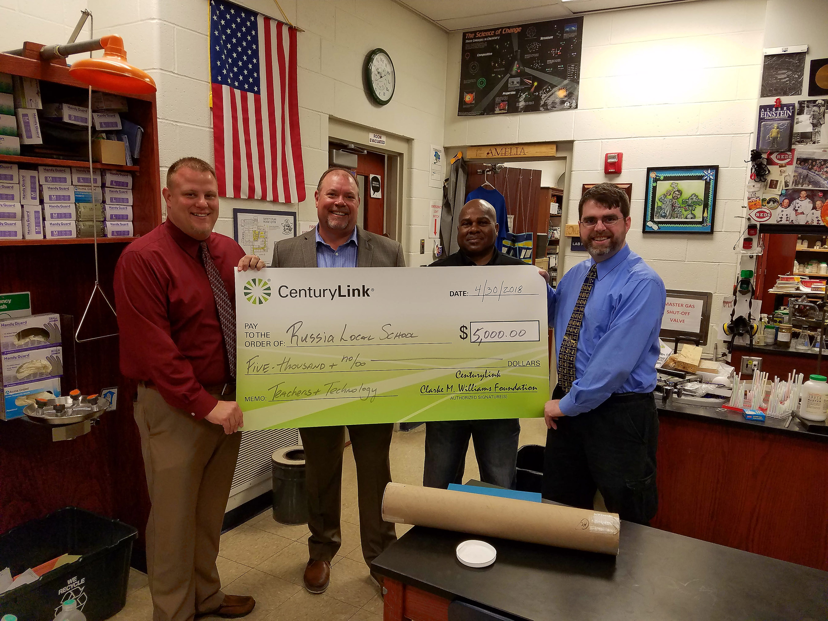 Russia (Ohio) Local School Principal, Brian Hogan, CenturyLink's Herb Cavanah and Todd White with Science teacher Eric Sullenberger accepting a Teachers and Technology grant award from CenturyLink to build his project, Digital Data Collection for Physics.