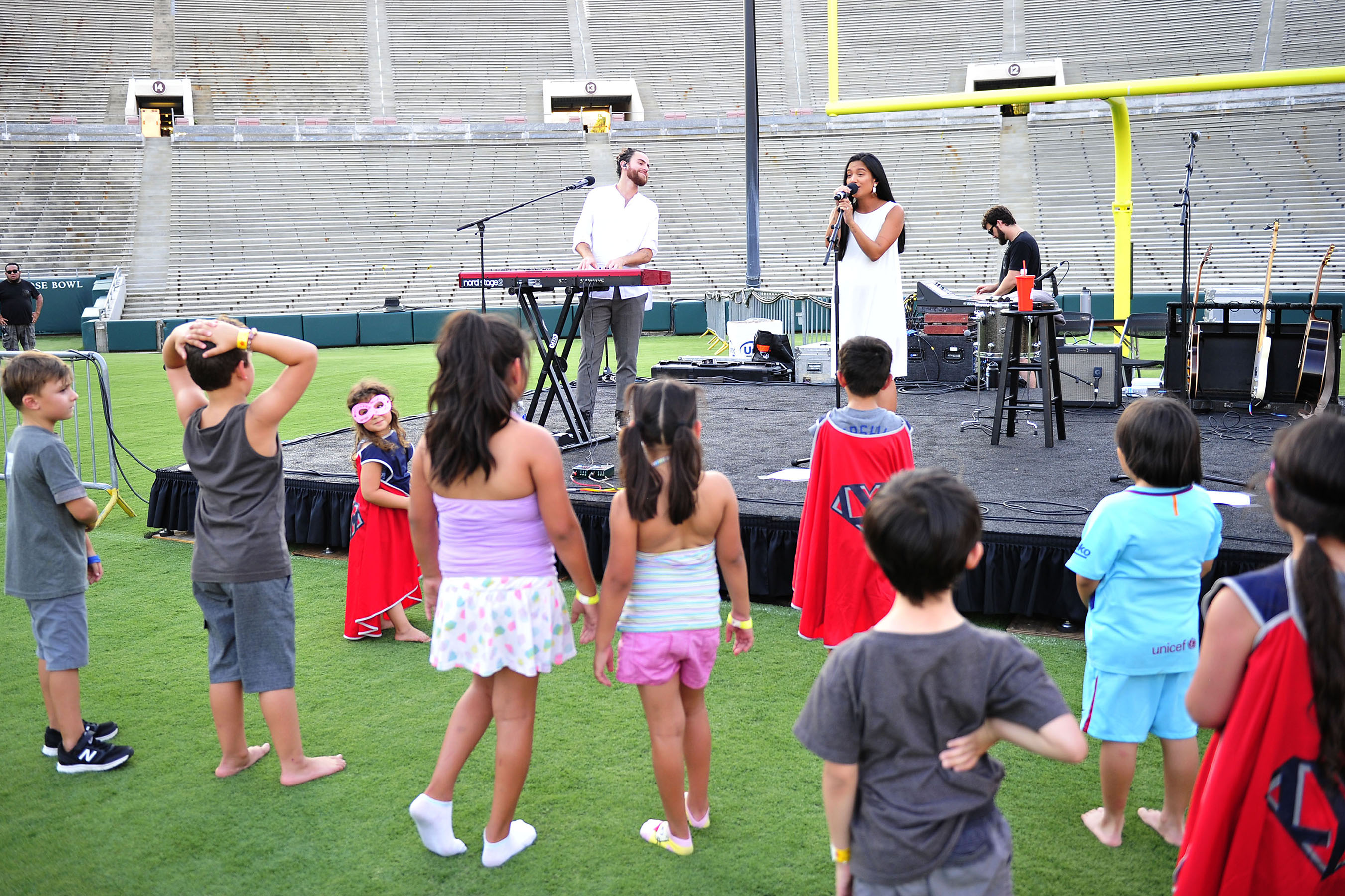 Us the Duo performs for families affected by childhood cancer at Campout on the Field, an event co-hosted by Northwestern Mutual, the Rose Bowl Stadium and Rose Bowl Legacy Foundation.