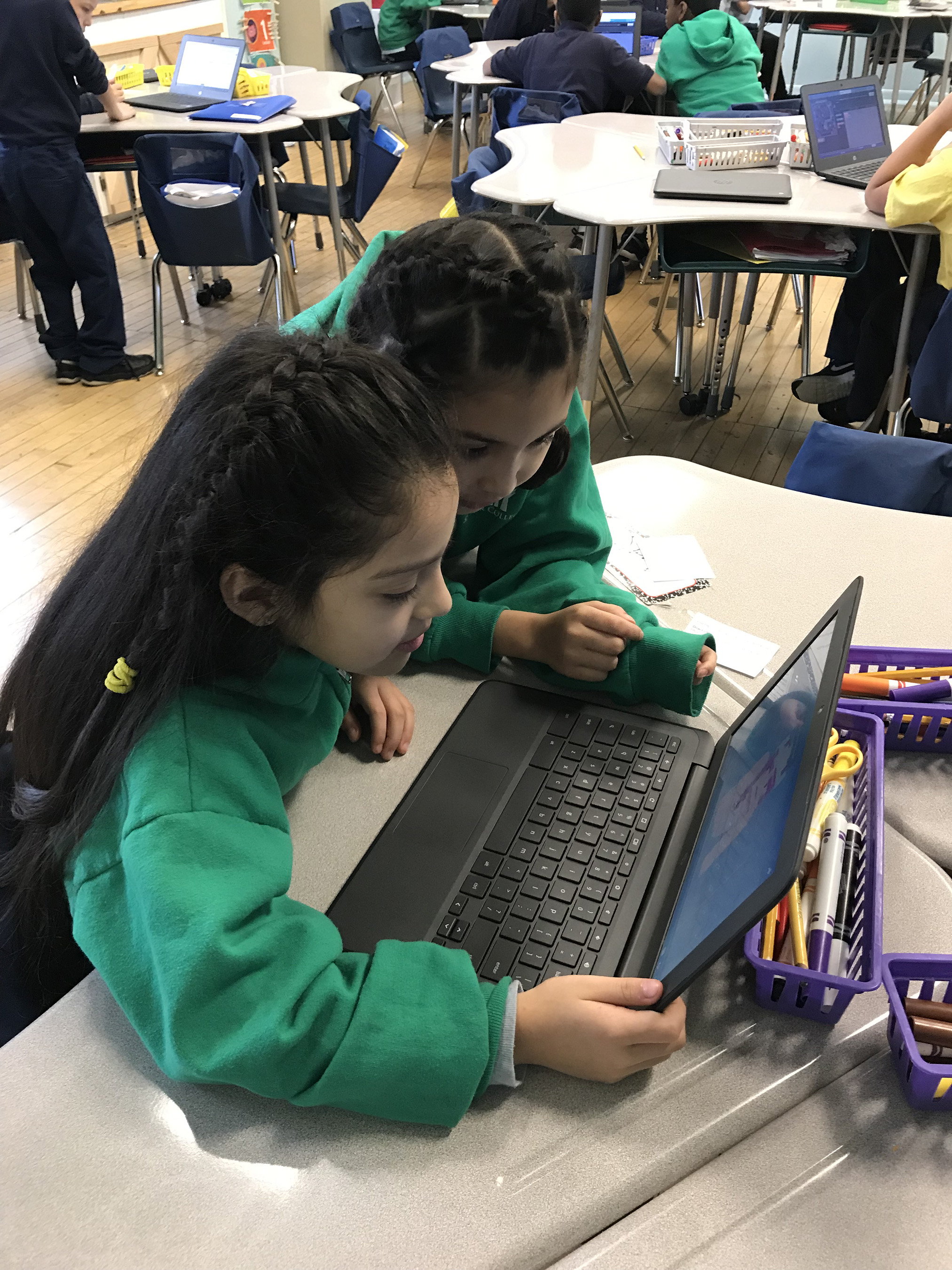 Students from Stellar Collegiate Charter School of Milwaukee worked together to solve challenges in Minecraft during an Hour of Code event led by Northwestern Mutual Senior Engineer Holly Murphy.