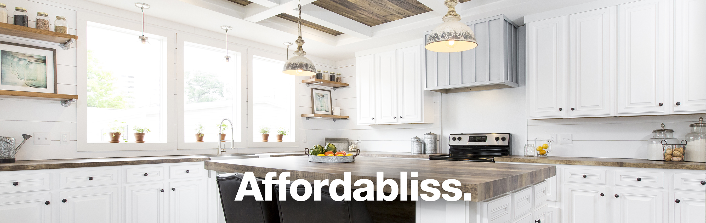 "Modern kitchen with text tagline overlay saying, ""Affordabliss."""