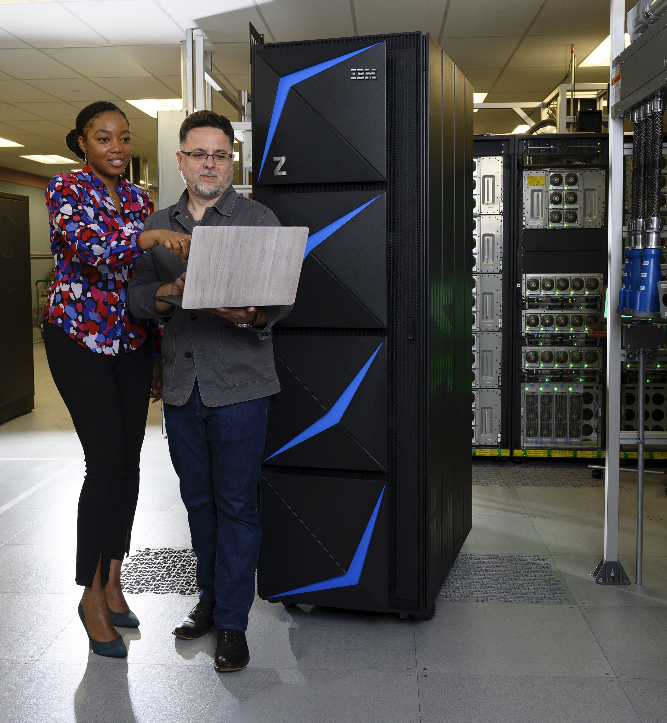 IBM Designers, Shani Sandy (L) and Don Spangler, review last minute specifications on the new z15 after four years of collaboration with 100 clients to build the enterprise system on Thursday, September 12, 2019, Poughkeepsie, NY. IBM announced the new system will have an industry-first capability to instantly revoke access to data across the hybrid cloud. IBM z15 can process up to 1 trillion web transactions a day and features new cloud-native development tools and instant recovery technology to optimize resiliency. (Jon Simon/Feature Photo Service for IBM)