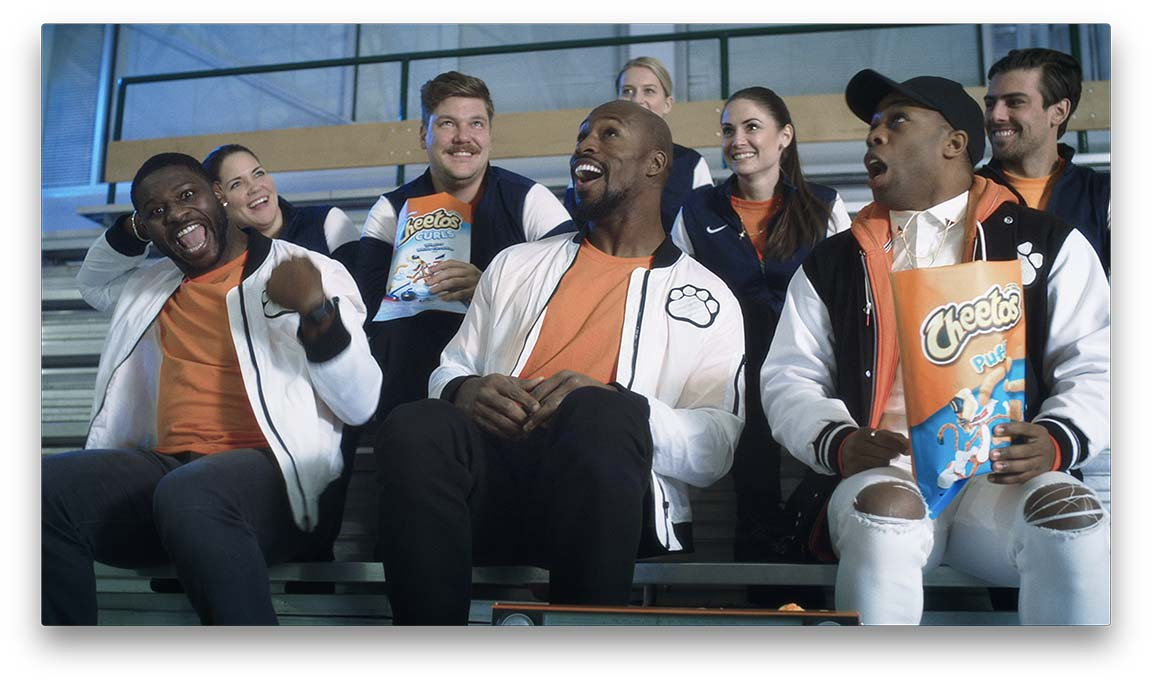 "Todrick Hall, LaDainian Tomlinson, Vernon Davis and members of the USA Curling Team on set of the ""Teach Me How to Curl"" music video set."