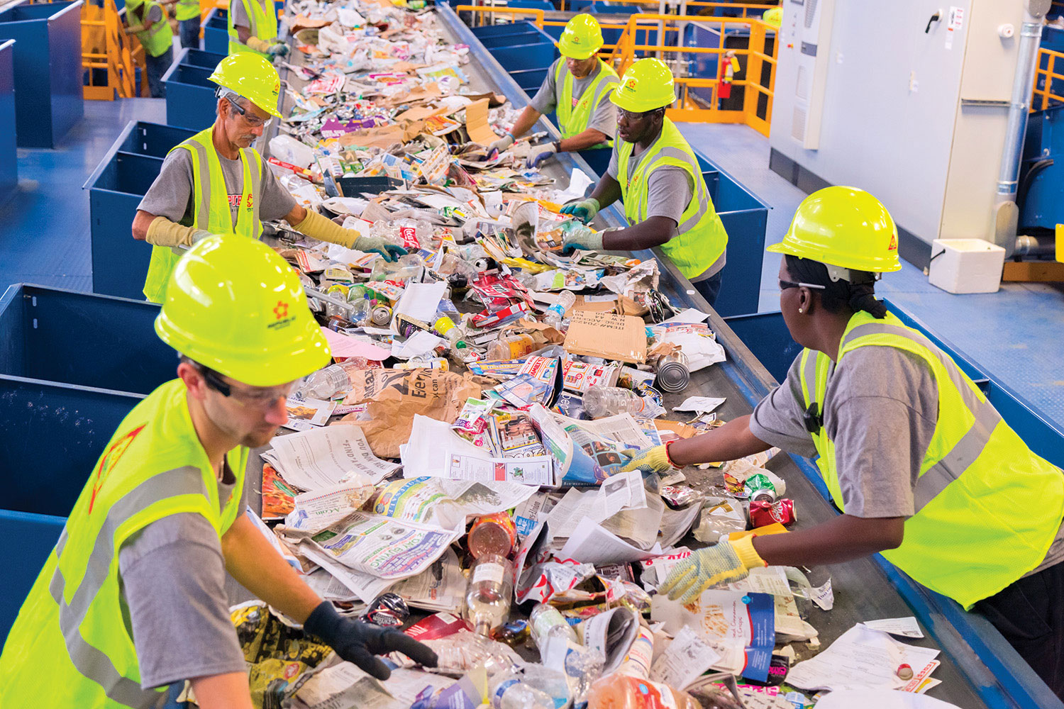 Sorting recyclables at a Republic Services facility.