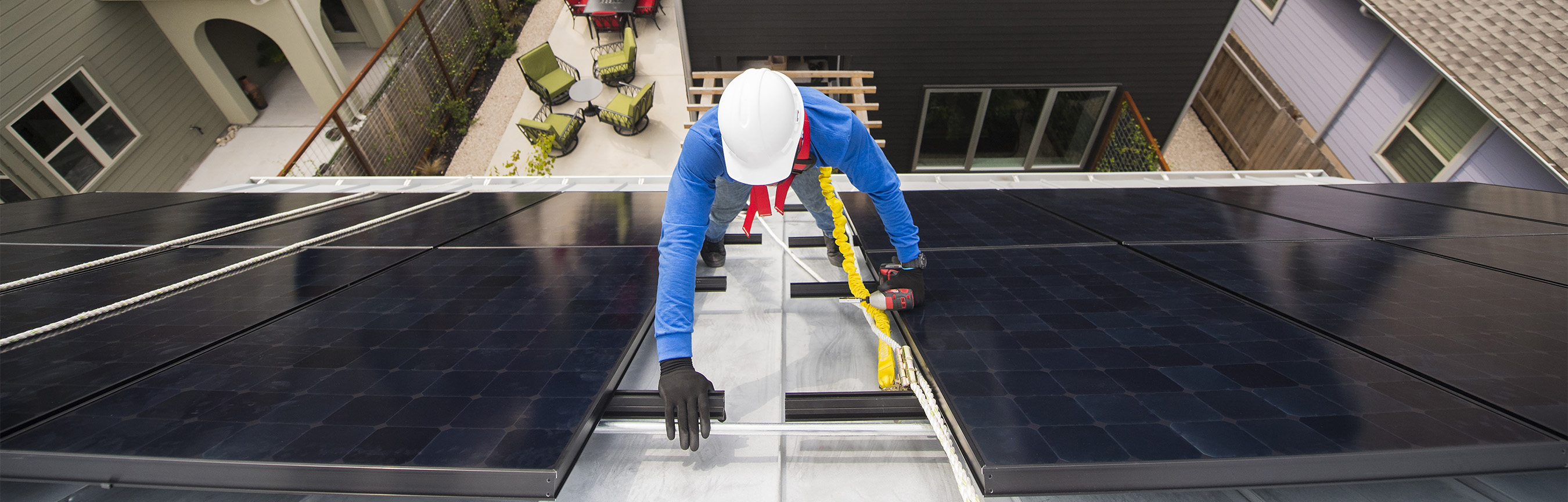 SunpPower tech on a roof installing solar panels.