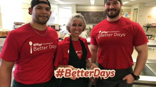 Volunteers hold up a Better Days sign